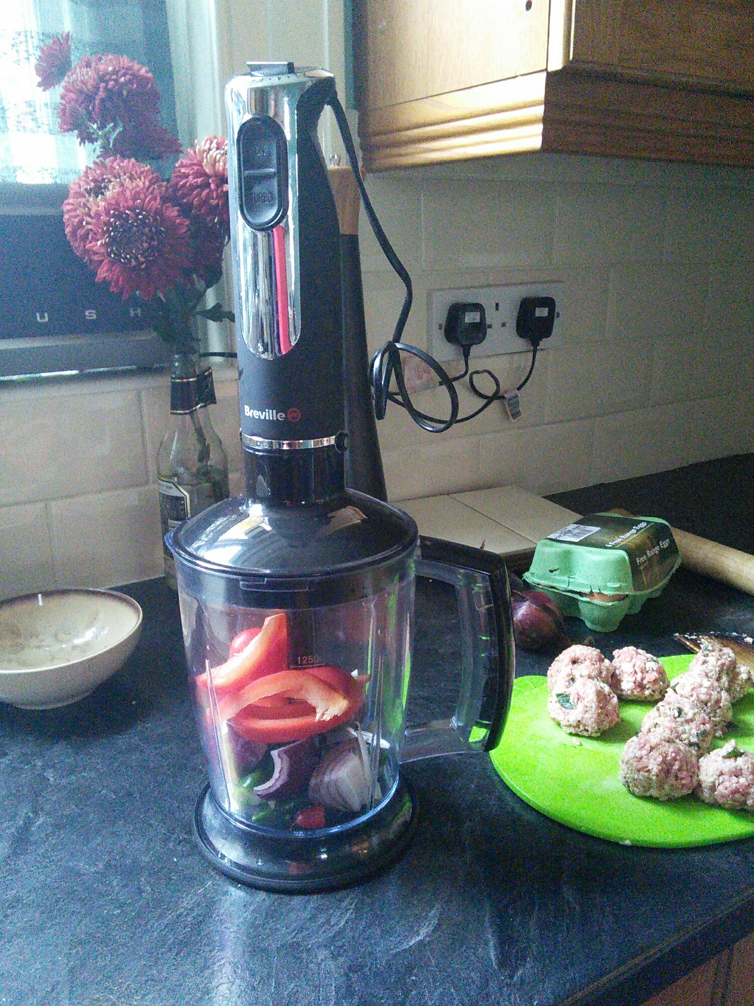 Harissa time - Chop the chilli's, red onion  and pepper with herbs and ground spices