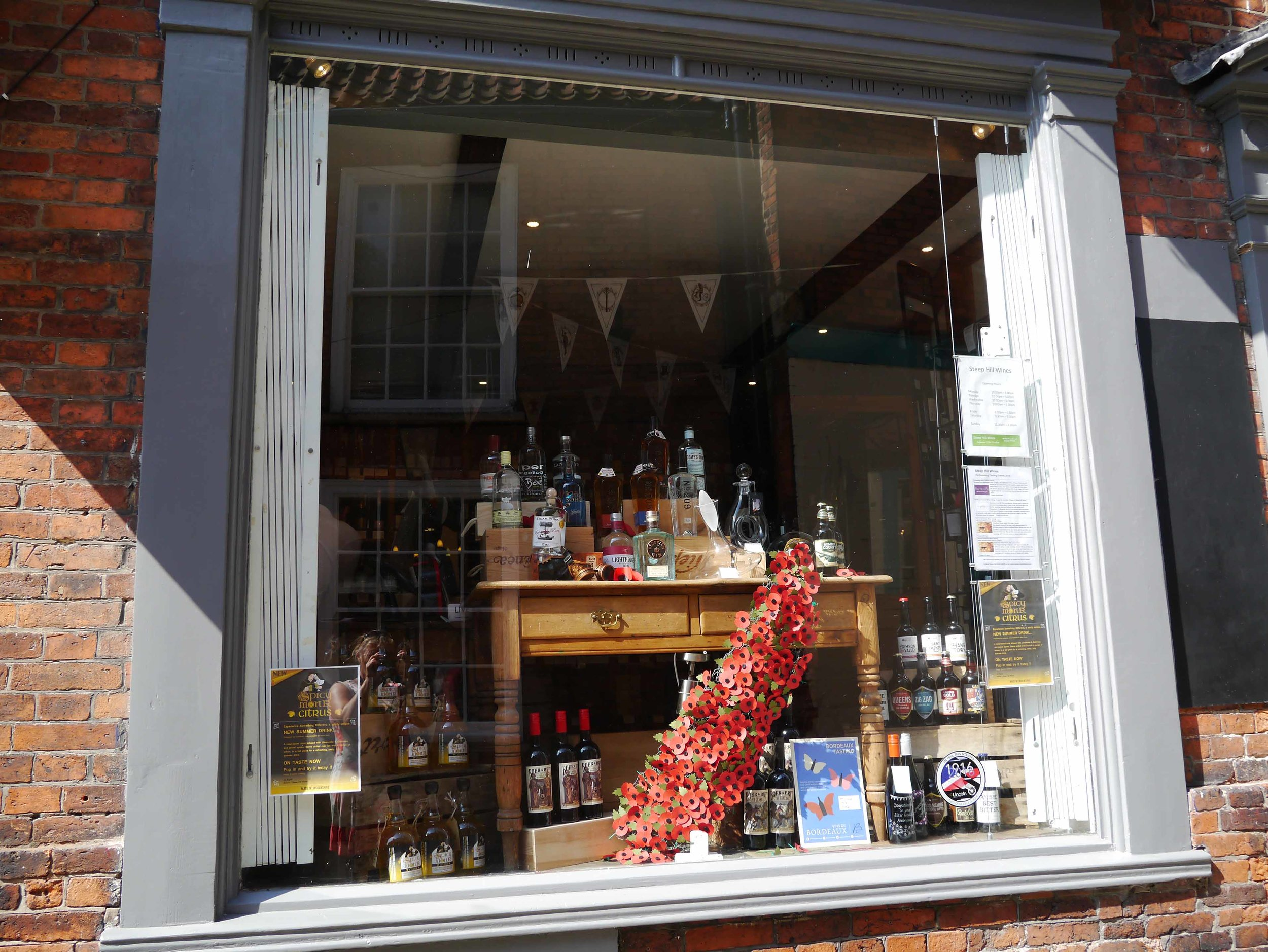 Lincoln Steep Street shop with poppy display