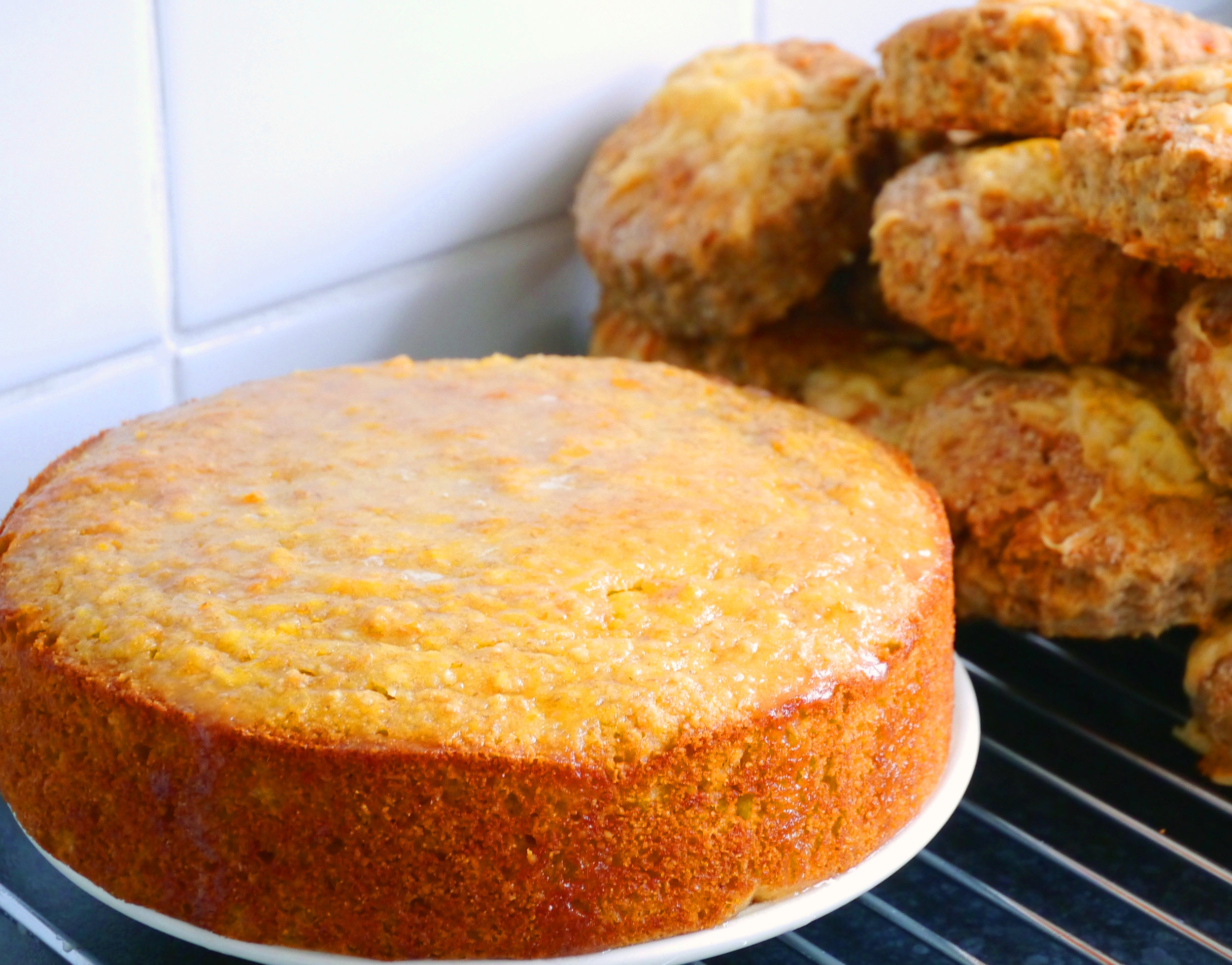 Back at home and it's family tea Sunday. I'm actually able to potter about baking without the awful encumbrance of a crutch so have had a baking splurge. Some easy sourdough cheese scones and a new Orange and Almond cake recipe. The interesting thing about this cake is that you poach a whole orange for about 30 mins in a pan of boiling water and then blitz it in a food processor until you have a puree. The eggs and sugar are whipped until light and frothy and then the flour (I used spelt) and ground almonds and baking powder are folded into the eggy mix, followed by the orange puree. So easy to do. It's then baked for about 40 mins at 160C until the top is golden and springy. After cooling for a while I mixed some icing sugar with clementine juice and drizzled over the top. 1 orange 3 eggs 140g castor sugar 85g flour (plus 1tsp baking powder if plain flour) 150g ground almonds