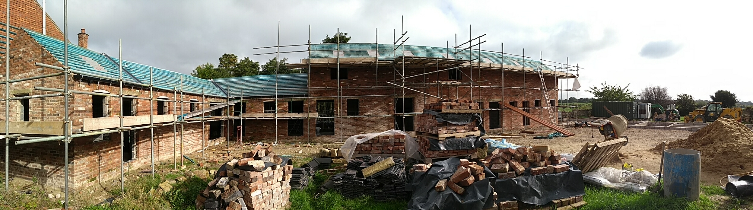 Panorama of barn 1 and 2. You can just see the footings for barn 3