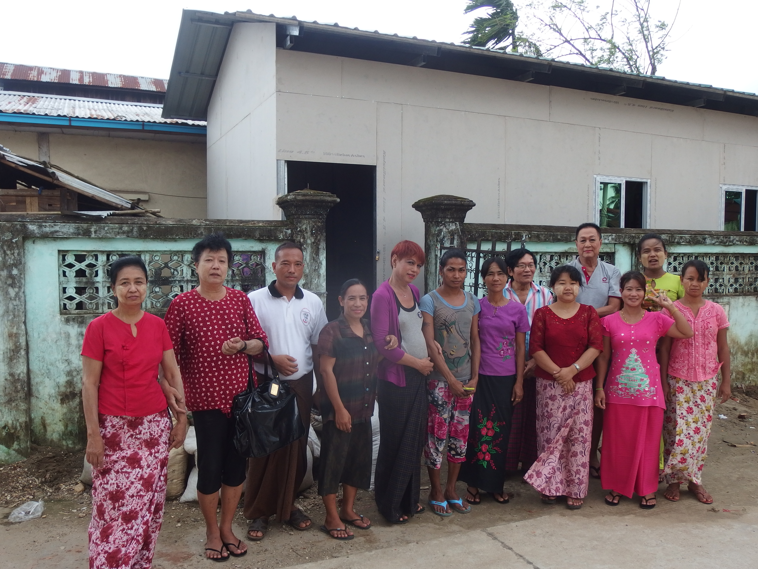 Staff and trainees outside the newly constructed vocational centre