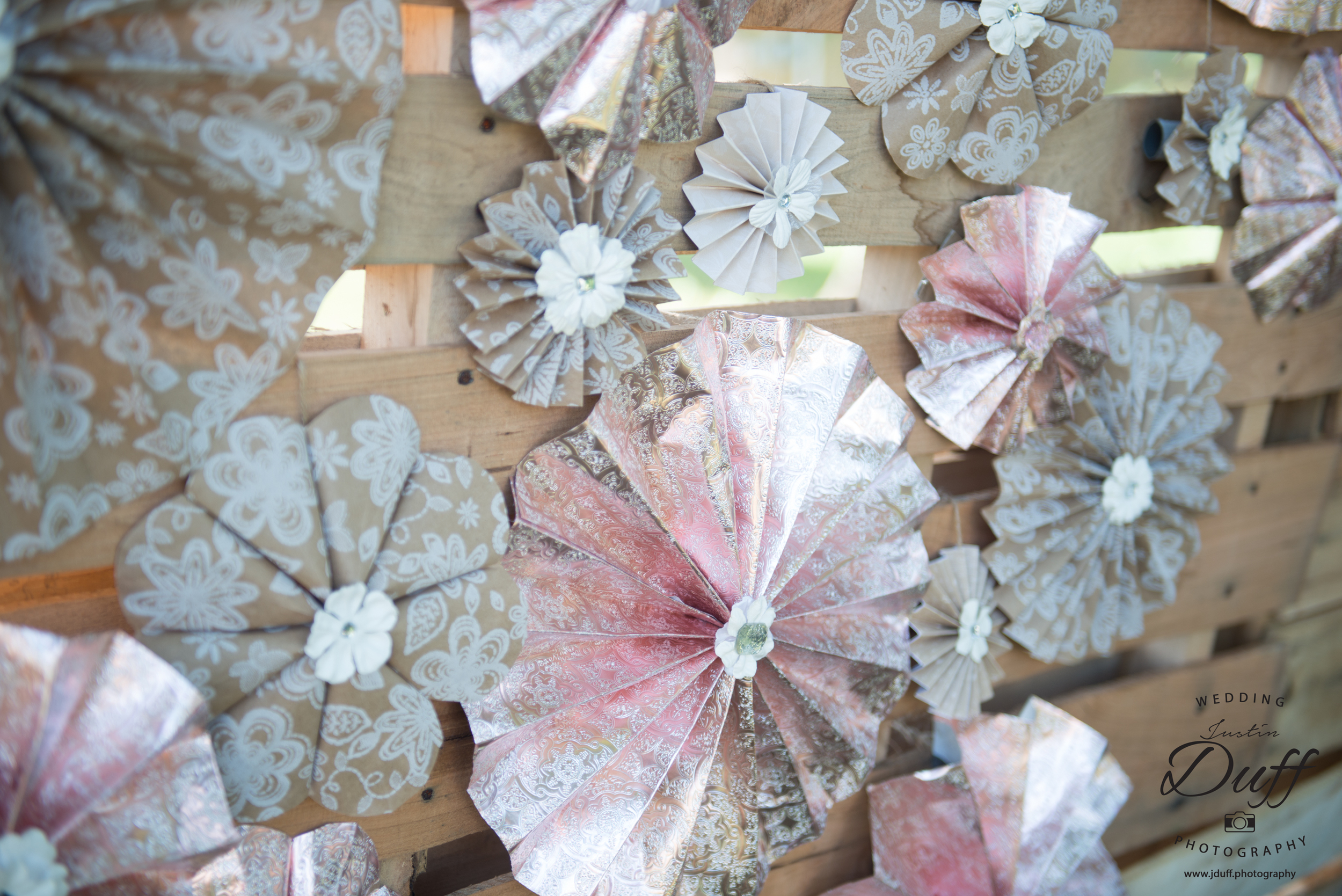 Firefighter Park Wedding - Troy MI wedding photographer. Hand made decorations cicular paper fans on a wooden bacdrop