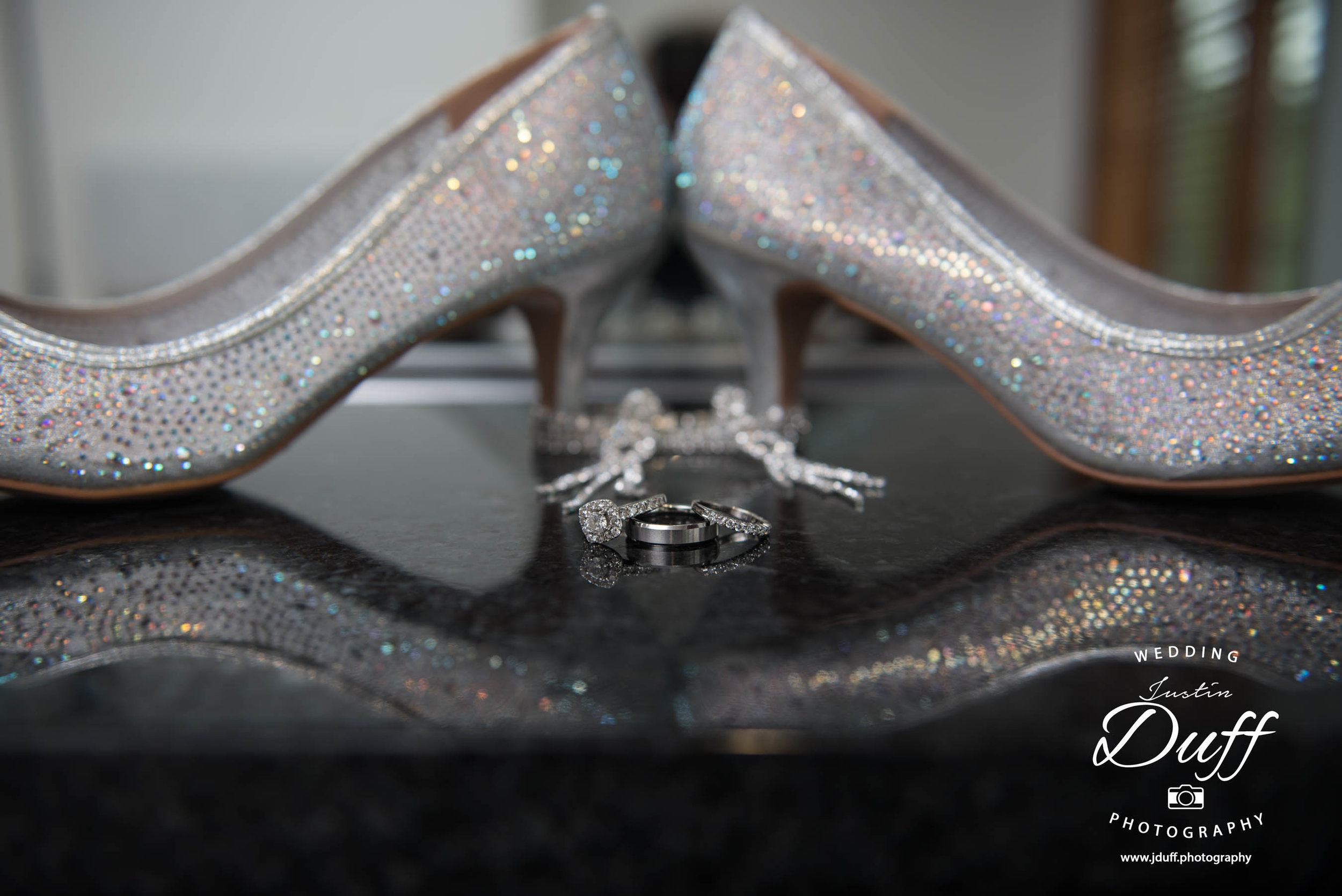Fountains Golf Course Wedding - Royal Oak Photographer – Deanna & Shane wedding rings and shoes reflecting