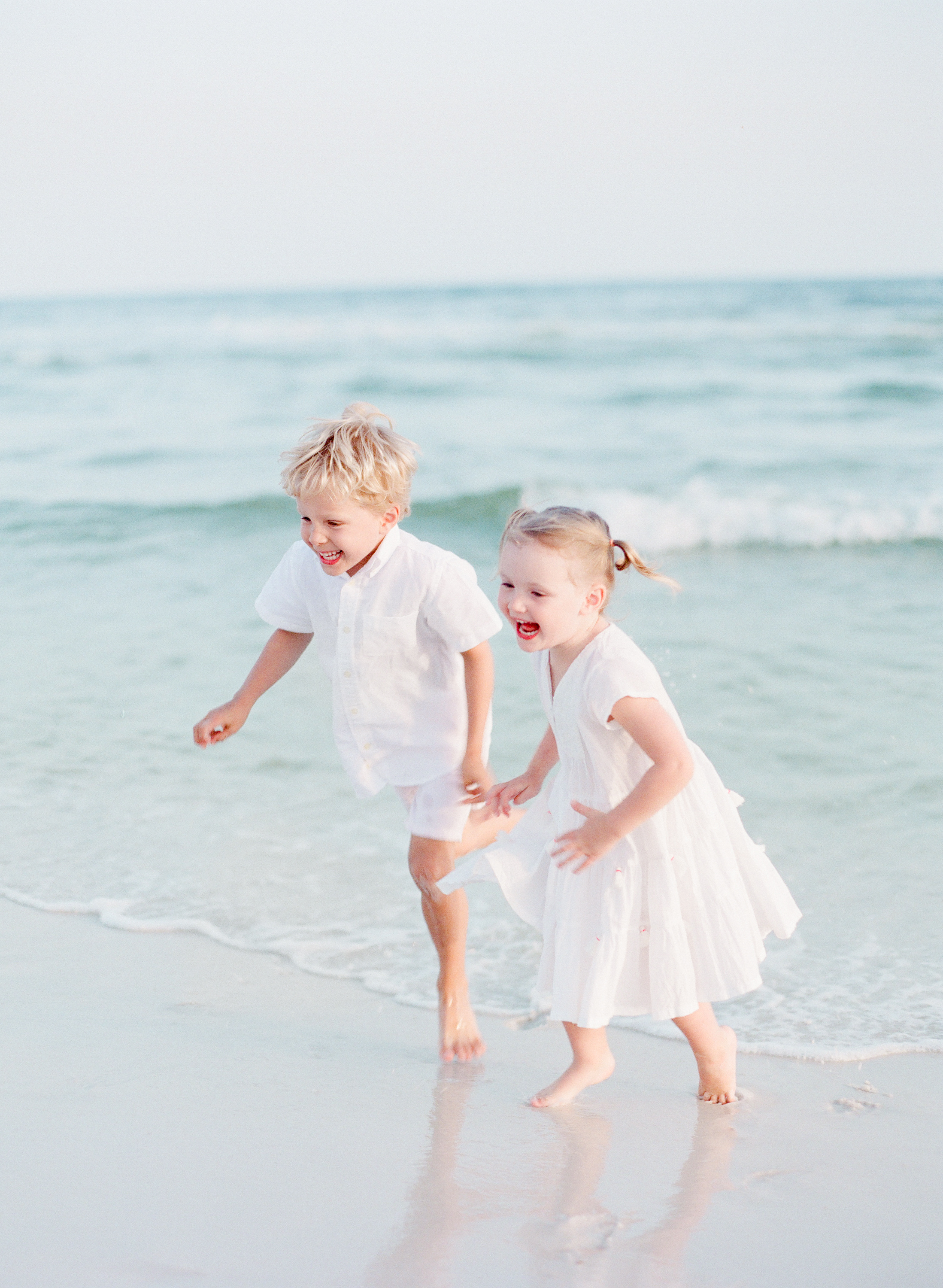 Kids playing at the beach | Kaylie B. Poplin Photography | Watercolor, Florida portrait and wedding photographer