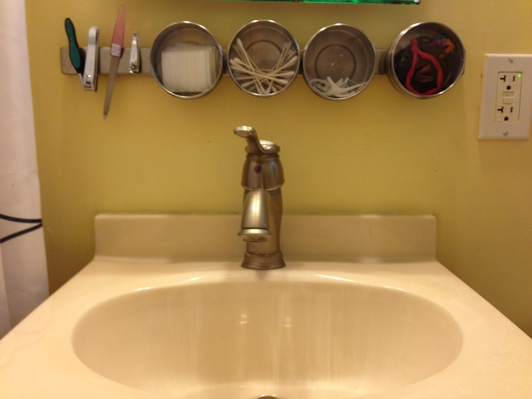 The Bathroom     I can barely turn around in the bathroom so every inch of space counts. I love this magnetic organizer that is meant for the kitchen, but also does a great job of storing those small, essential bathroom tools.