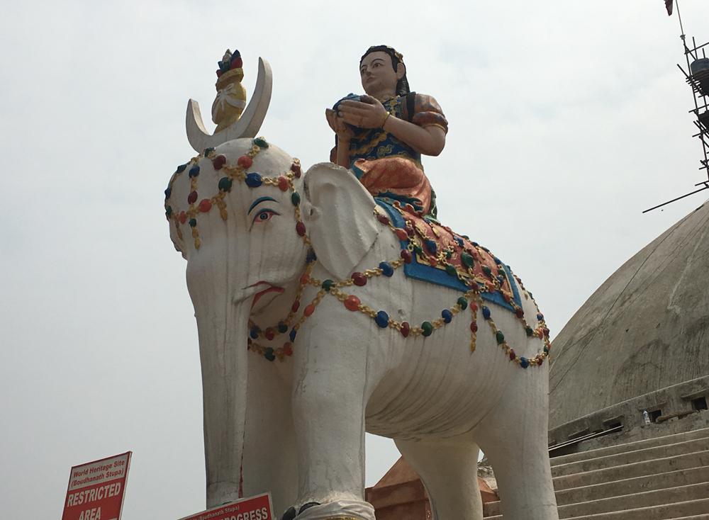 Elephant statue guarding the stupa