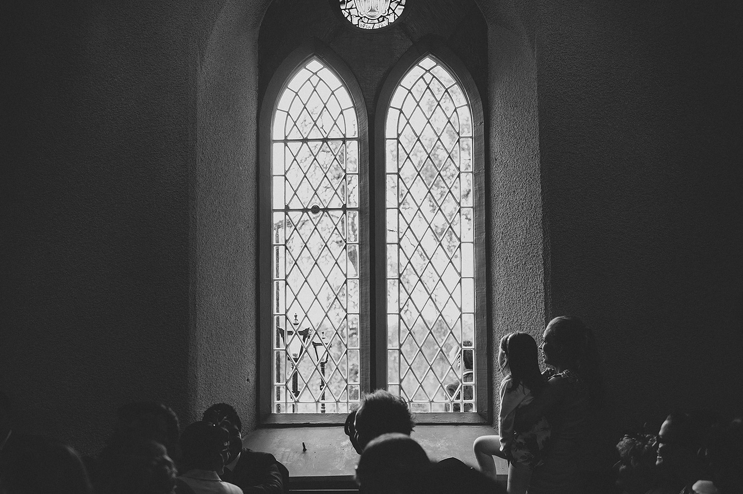 Child looking out church window