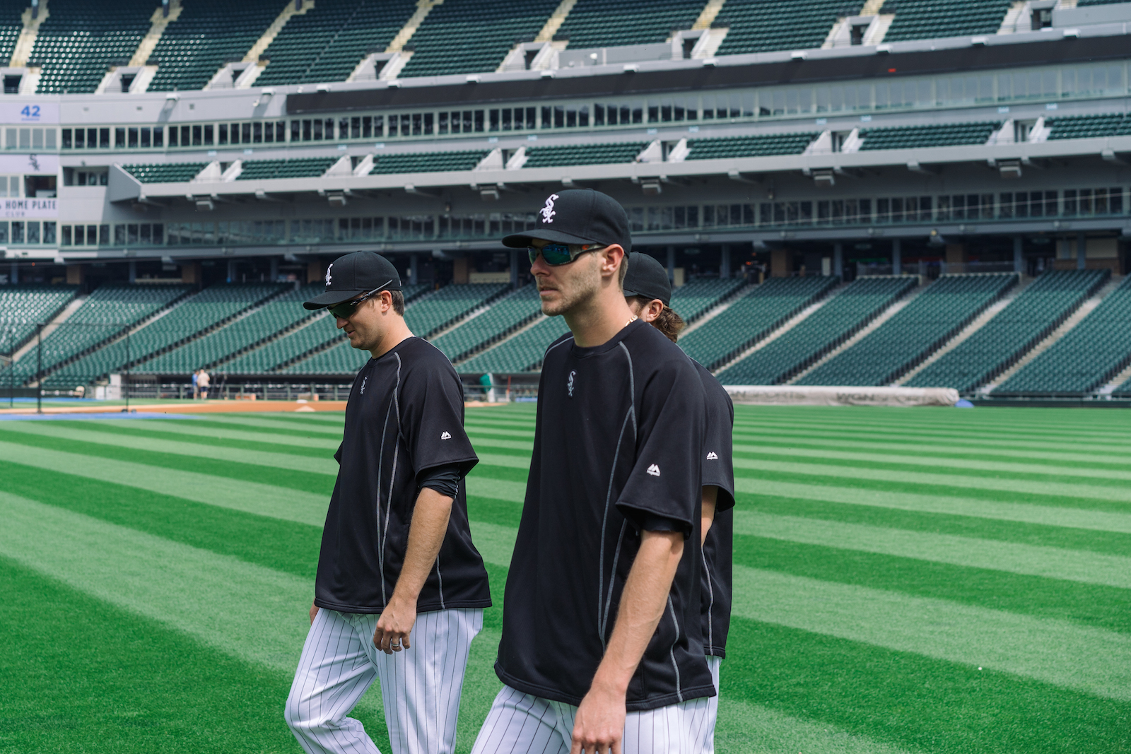 Chris Sale and fellow pitchers before taking selfies with fans.