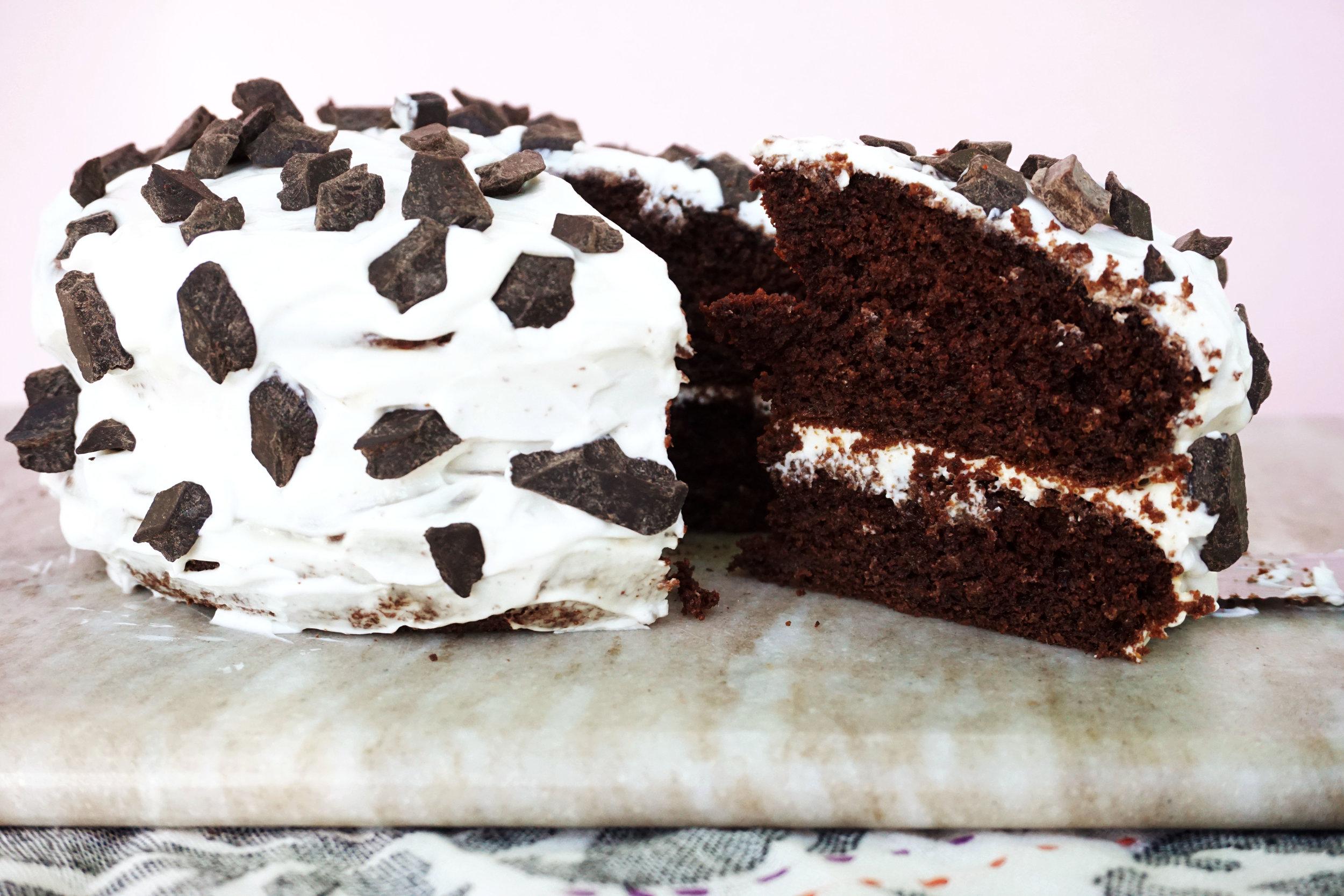 Chocolate-Studded Chocolate Cake w/ Vanilla Yogurt Frosting
