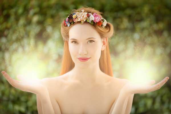 Beautiful-fairy-woman-with-glow-in-hands-on-natural-green-backgr-1.jpg