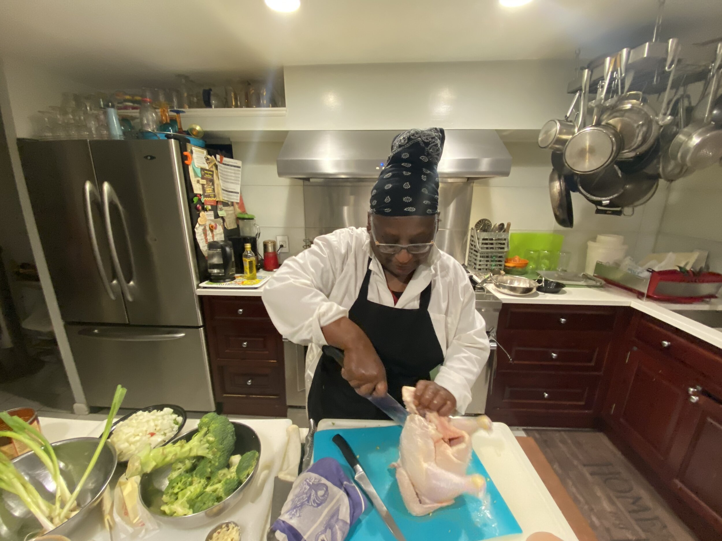 Chef Pearl instructing on cutting up a chicken sess. 5.jpeg