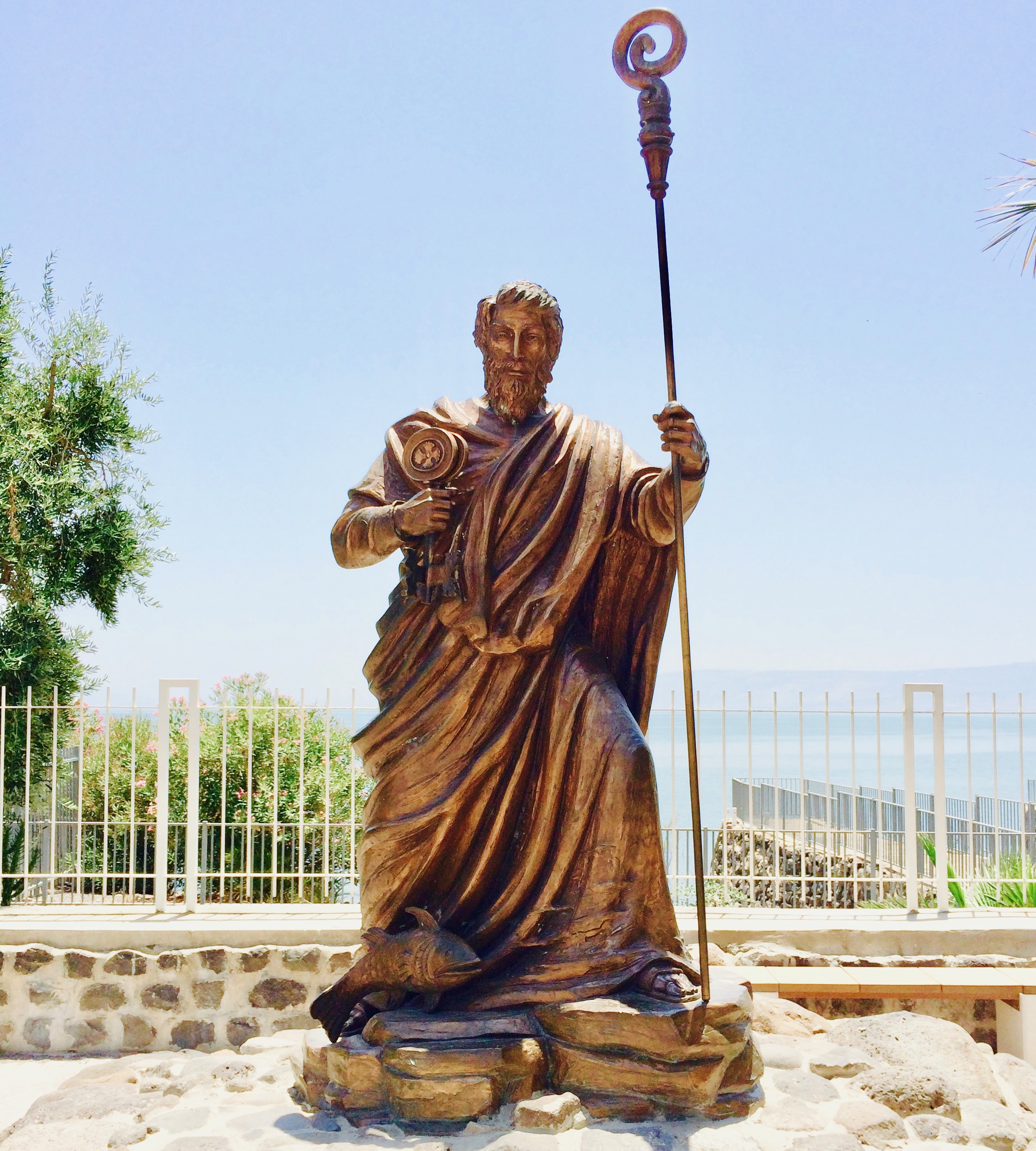 The statue of the Apostle Peter in Capernaum. The Sea of Galilee is in the background. Today I imagine Peter wielding the rod in his hand to protect the church from bad influences, and then using it as a staff to lead the flock in the right way.