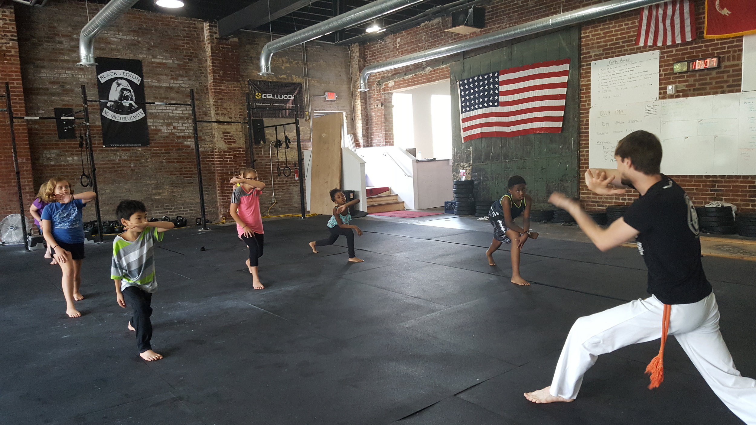 Students learn Capoeira from Educator Carl Bringenberg
