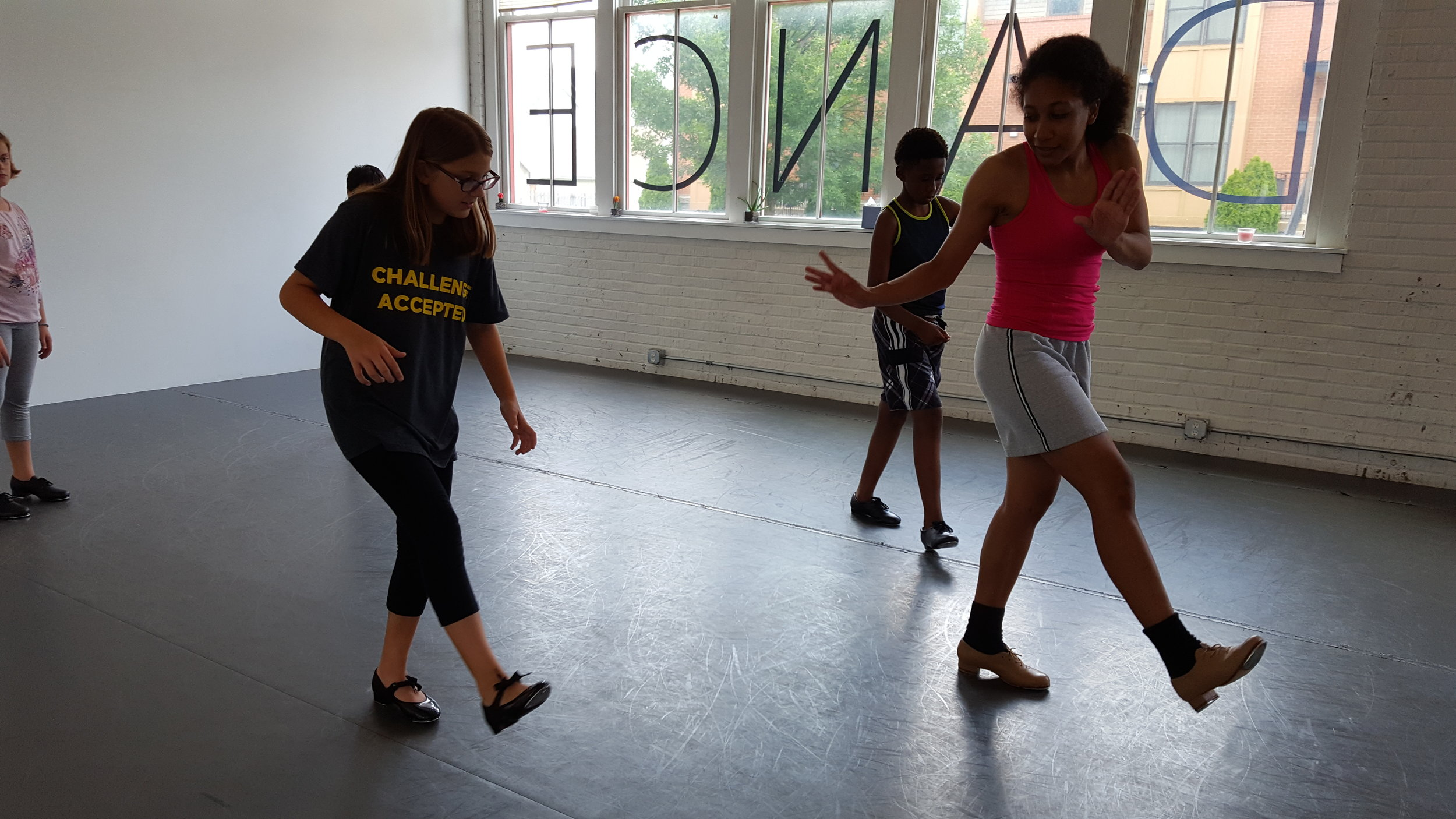 Students learn tap from Educator Olivia Perez