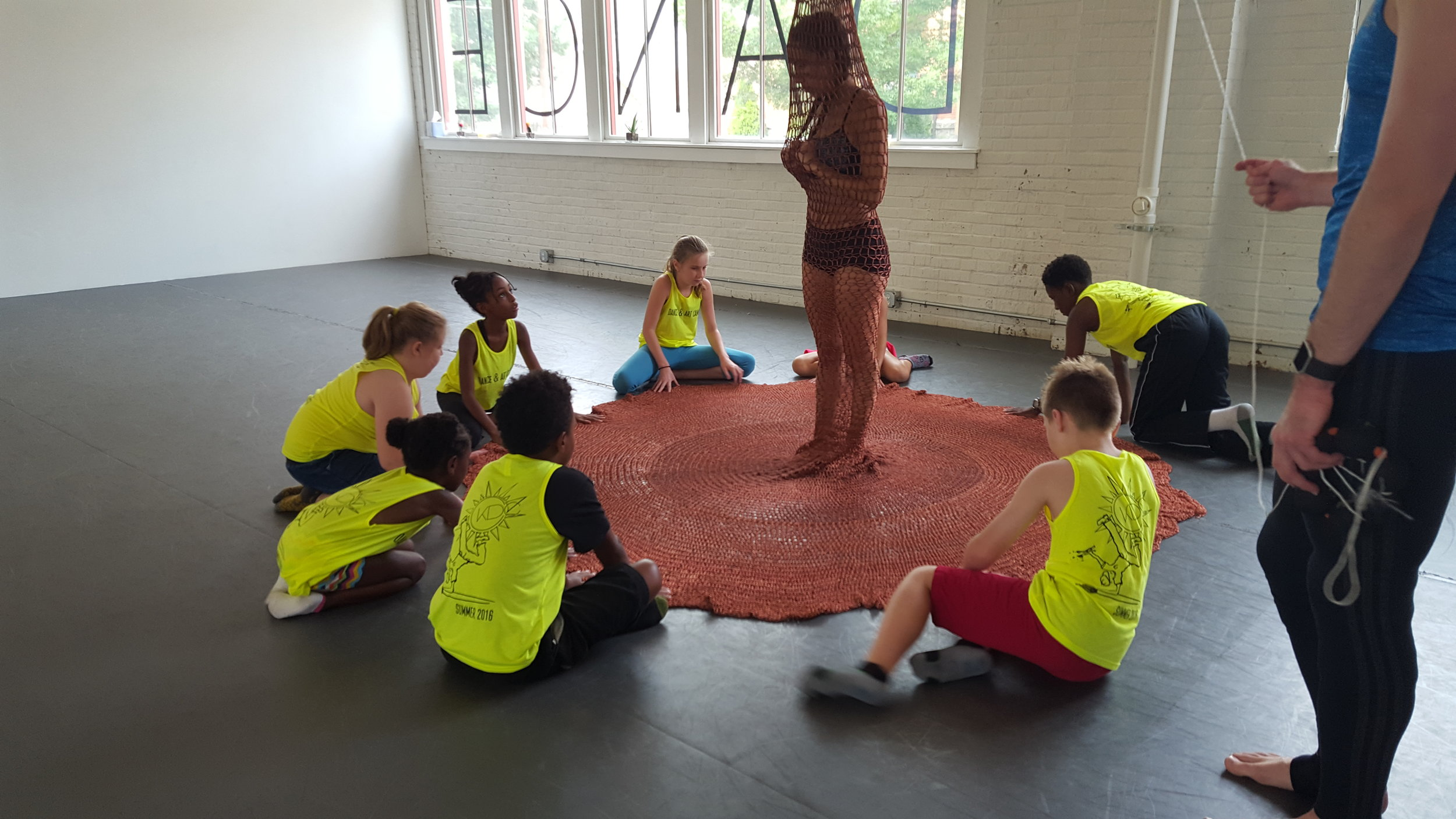 "Students help Artistic Director Madison DeWitt in the installation piece for company concert ""Take Root,"" Choreography by Arica Brown."