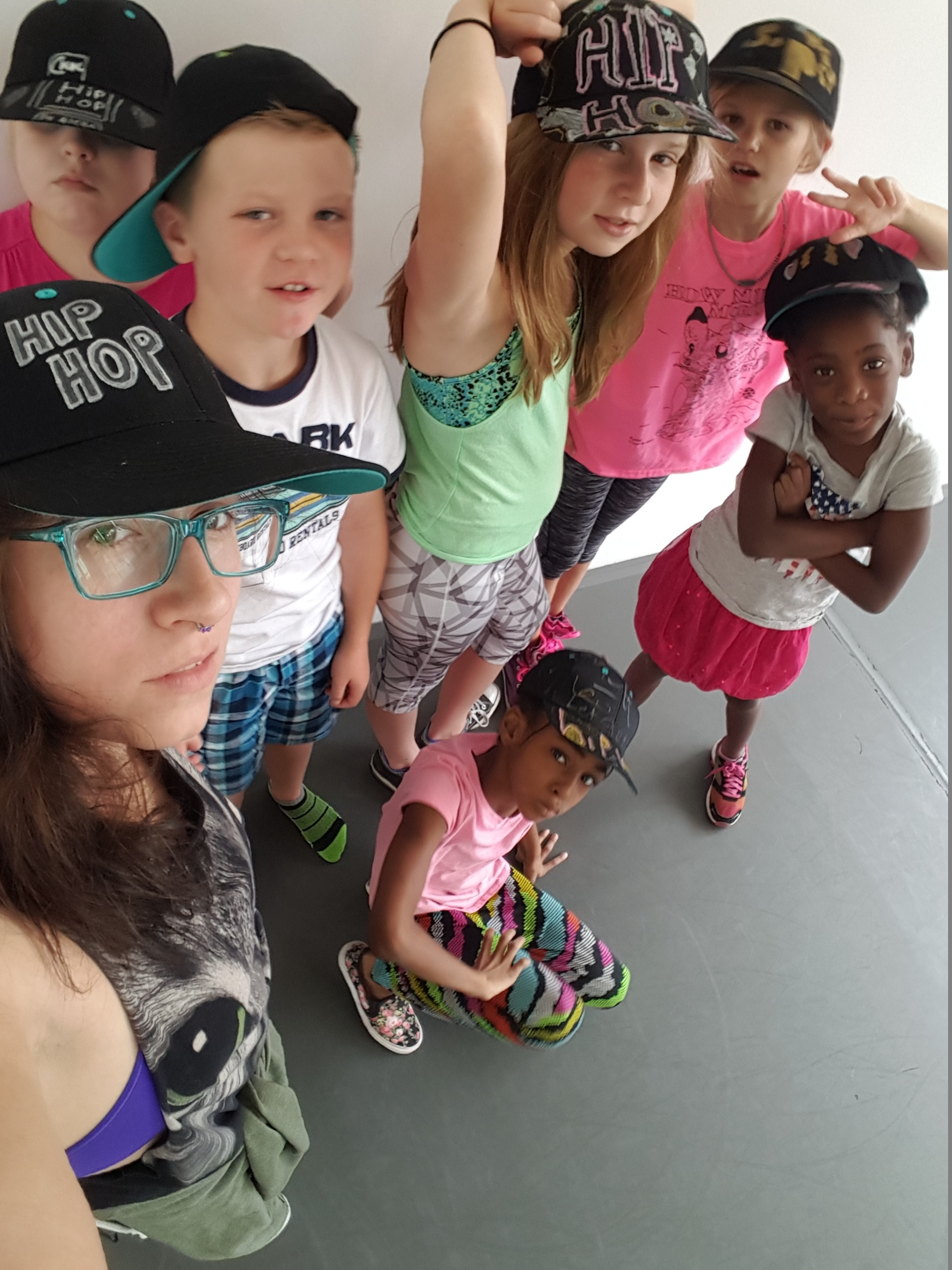 Students with Executive Director Arica Brown during Hip Hop week, after designing their own hats!