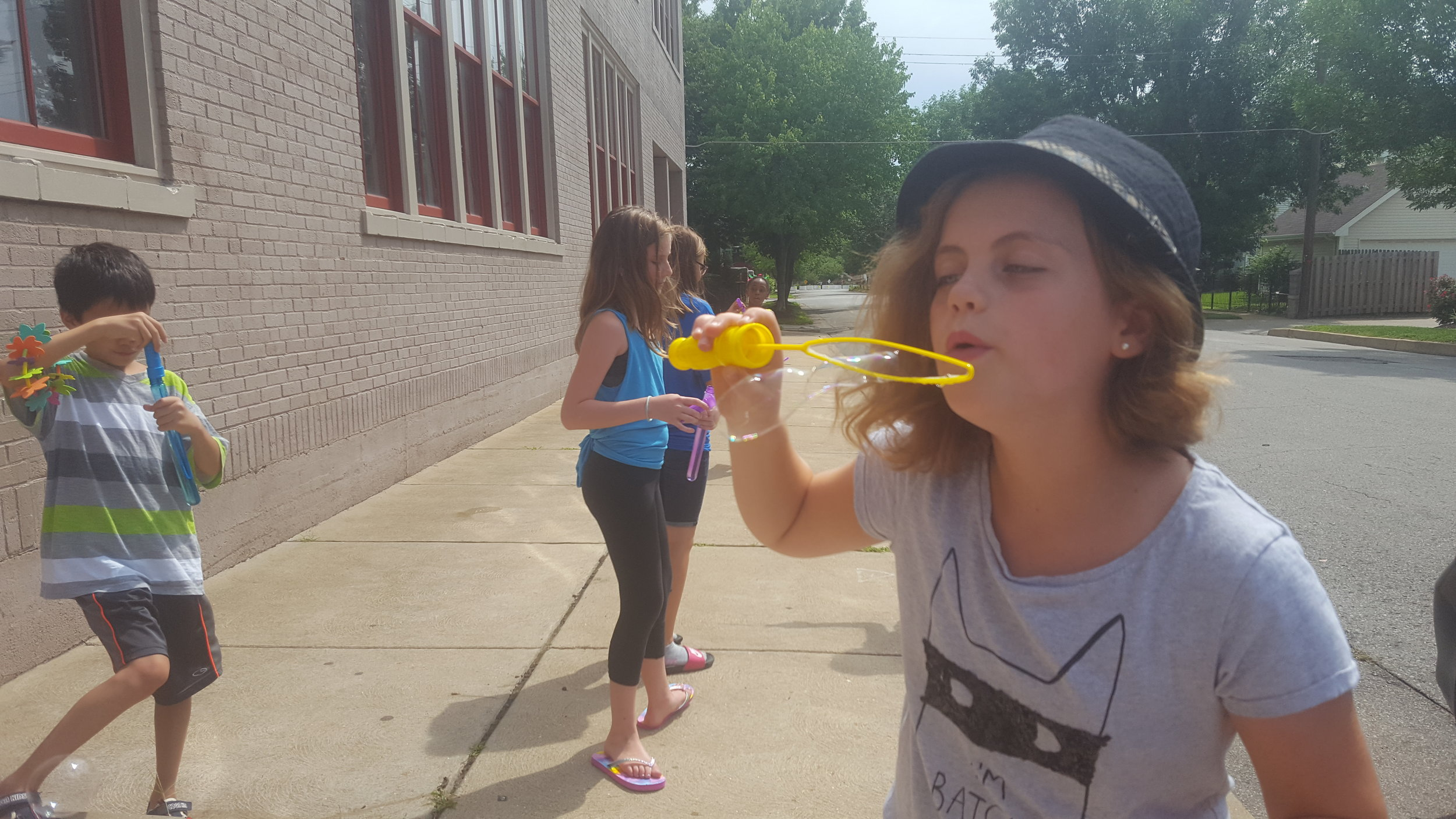 Students play with bubbles on a break between classes.