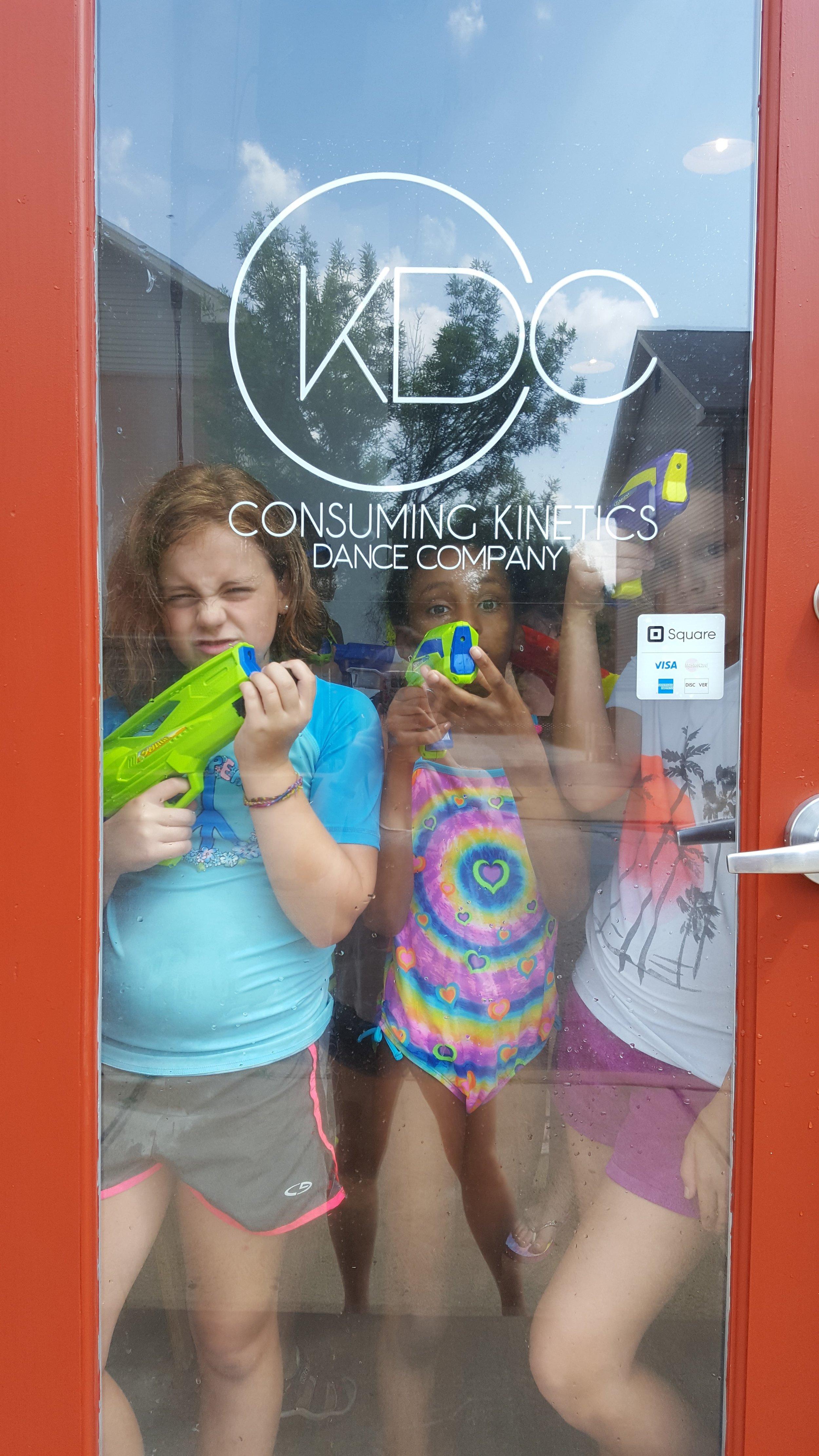 Kids prepare for a water-gun battle!