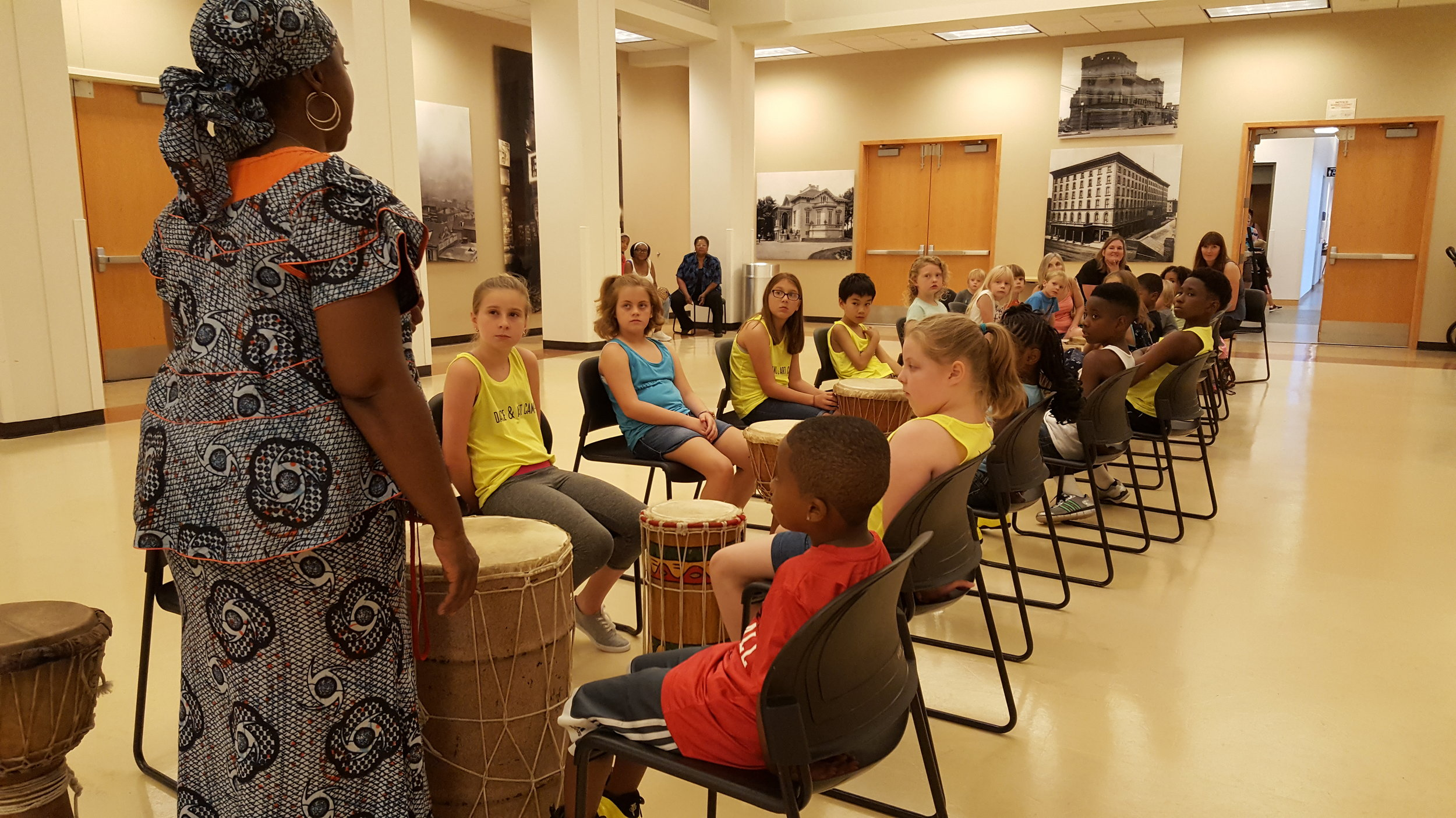 Students learn percussion/drumming skills from an educator at the St. Louis History Museum
