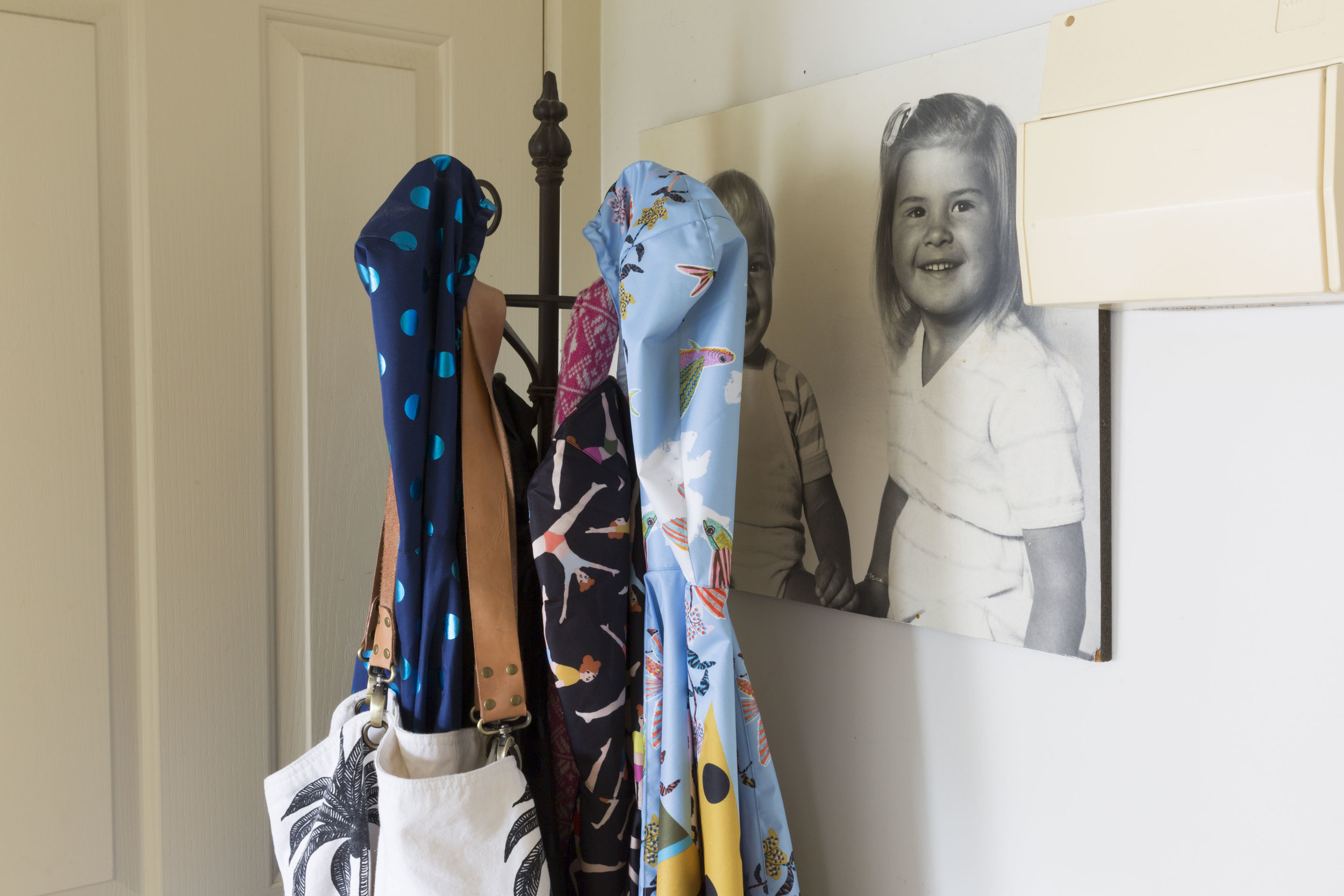 Justine Savage - Rented Space. Gorman raincoats and family photo.
