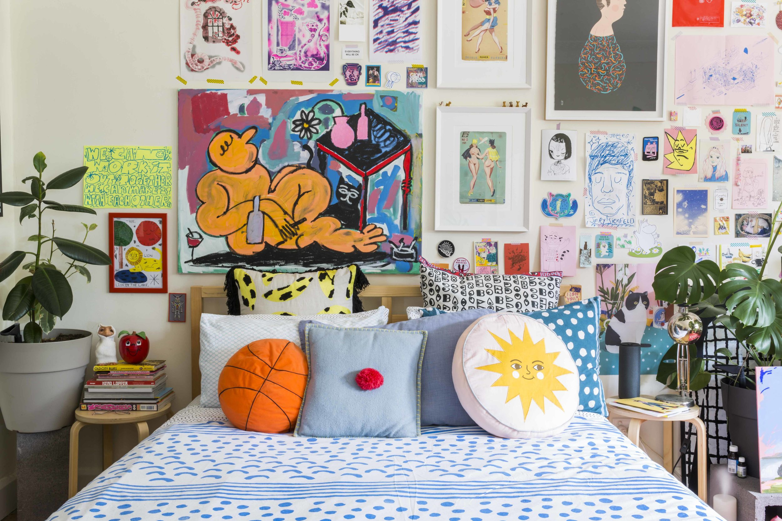 Above: Pillows and duvet cover from Arro Home, Ikea and Gorman. Big art pieces by Tae Parvit, The Seven Seas, Glom Press, Ryan Heshka and Robert Bowers. Below right:Painting by Dean Delandre, sword by Ghostpatrol,mid-century drawers from Inner West Buy Swap Sell Facebook Group