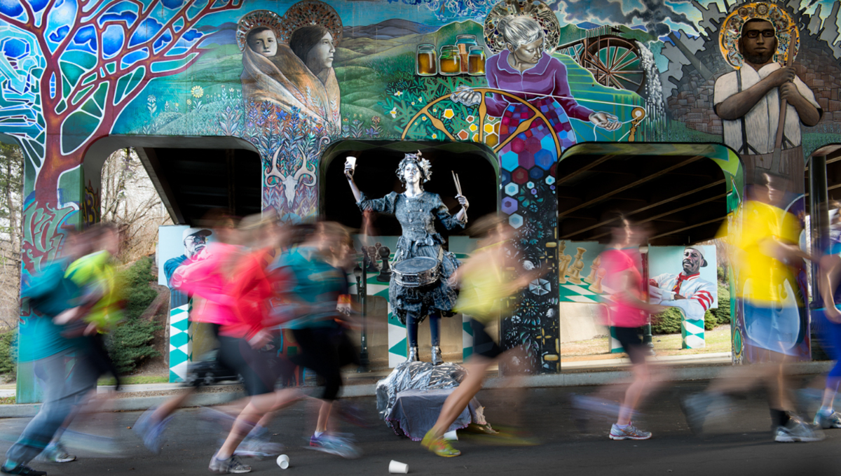 """Runners pass the """"Silver Lady"""" by the Lexington Avenue Bridge just down the road from Drover's Way"""