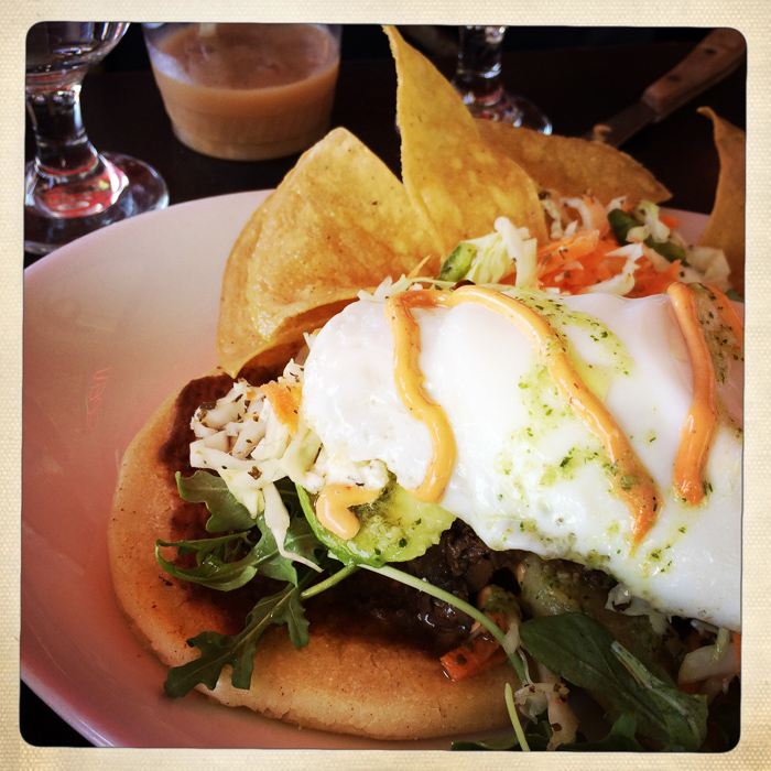 Vegetable papusas with  fried egg on top at La Bomba
