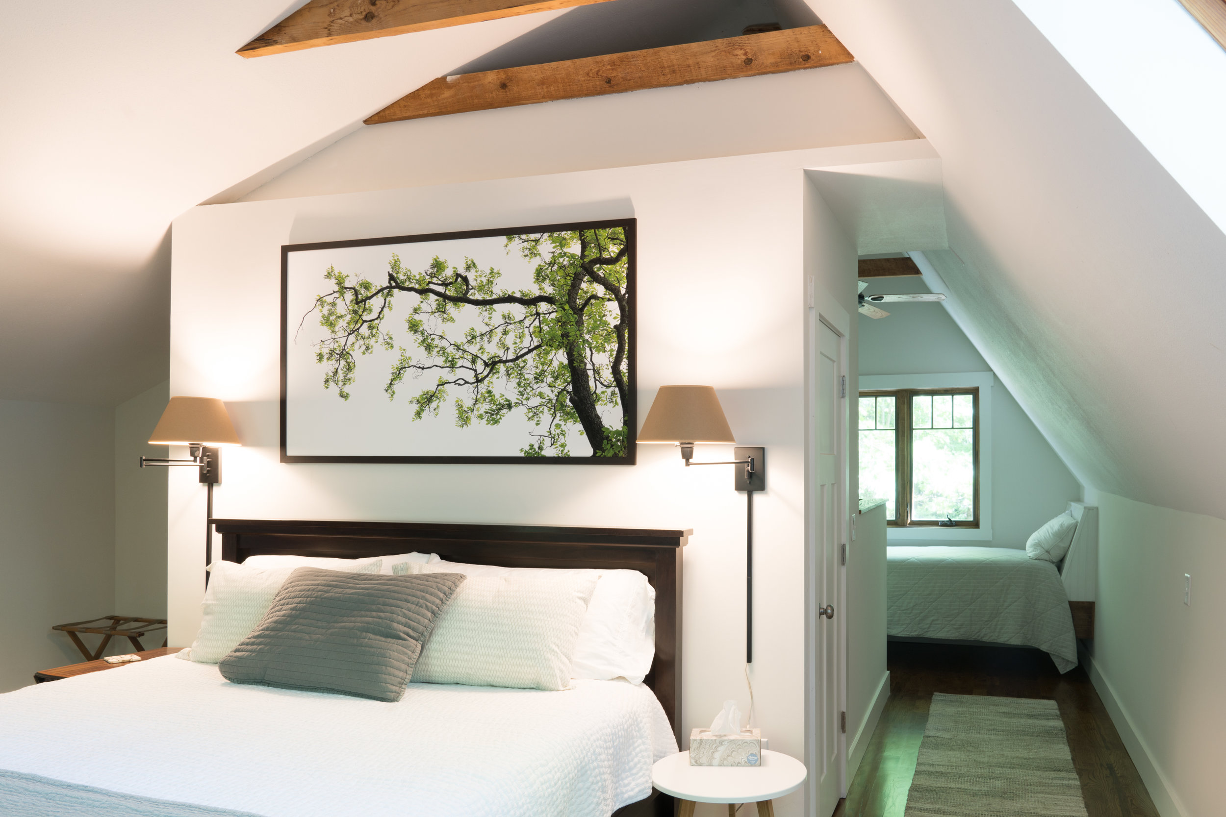 The lovely bedroom with a seriously comfy king bed with large windows allowing the sounds and view of nature. GREAT sleeping…