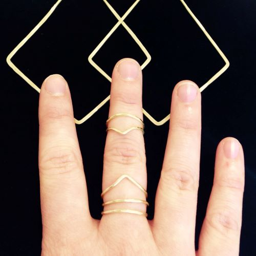 Triple Brass Rings by Essie Day $36: Add one to match your other rings, adding balance and flow. Or layer a few to create protective brass magic for a mythic royalty look. Direct your energies by facing your ring's point towards the body to receive and away to release. A variety of sizes & styles are available in the shop.
