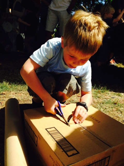 Concentrating hard on some serious cardboard box cubby creation.