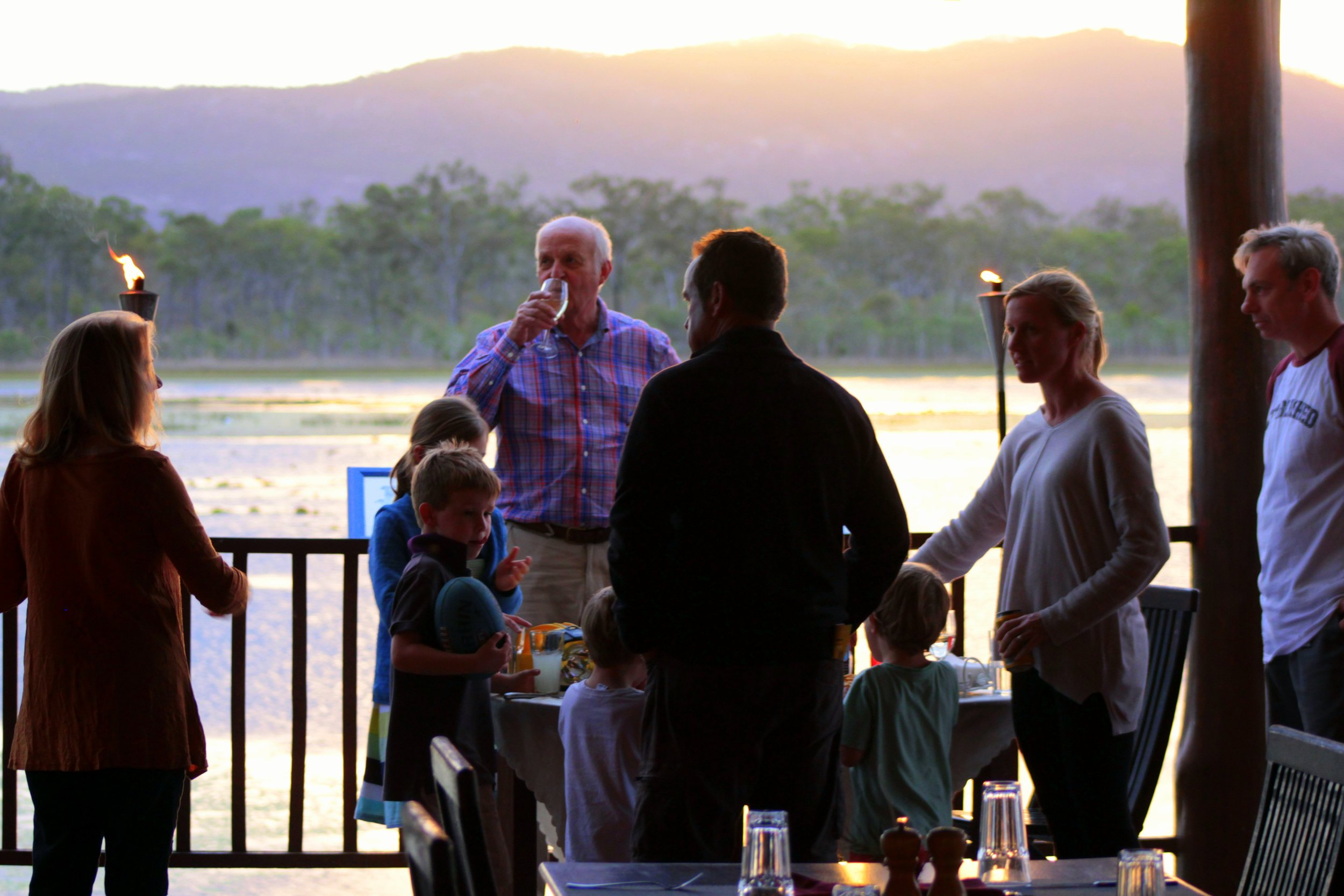 Sunset drinks on the deck for three generations