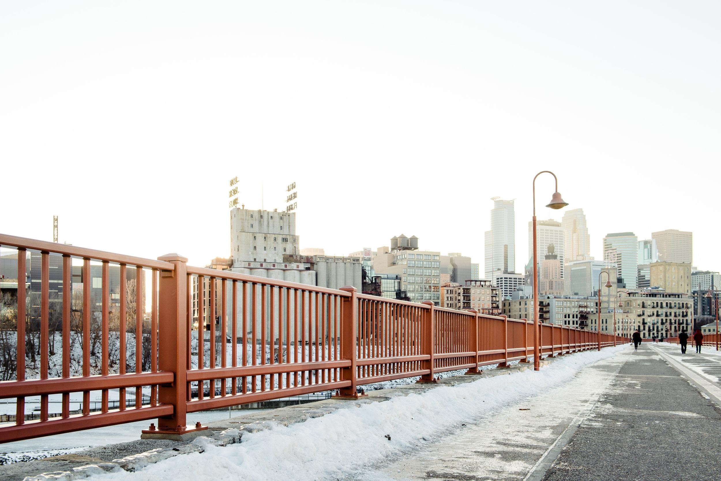 Stone Arch Bridge Minneapolis Skyline at Sunset in Winter