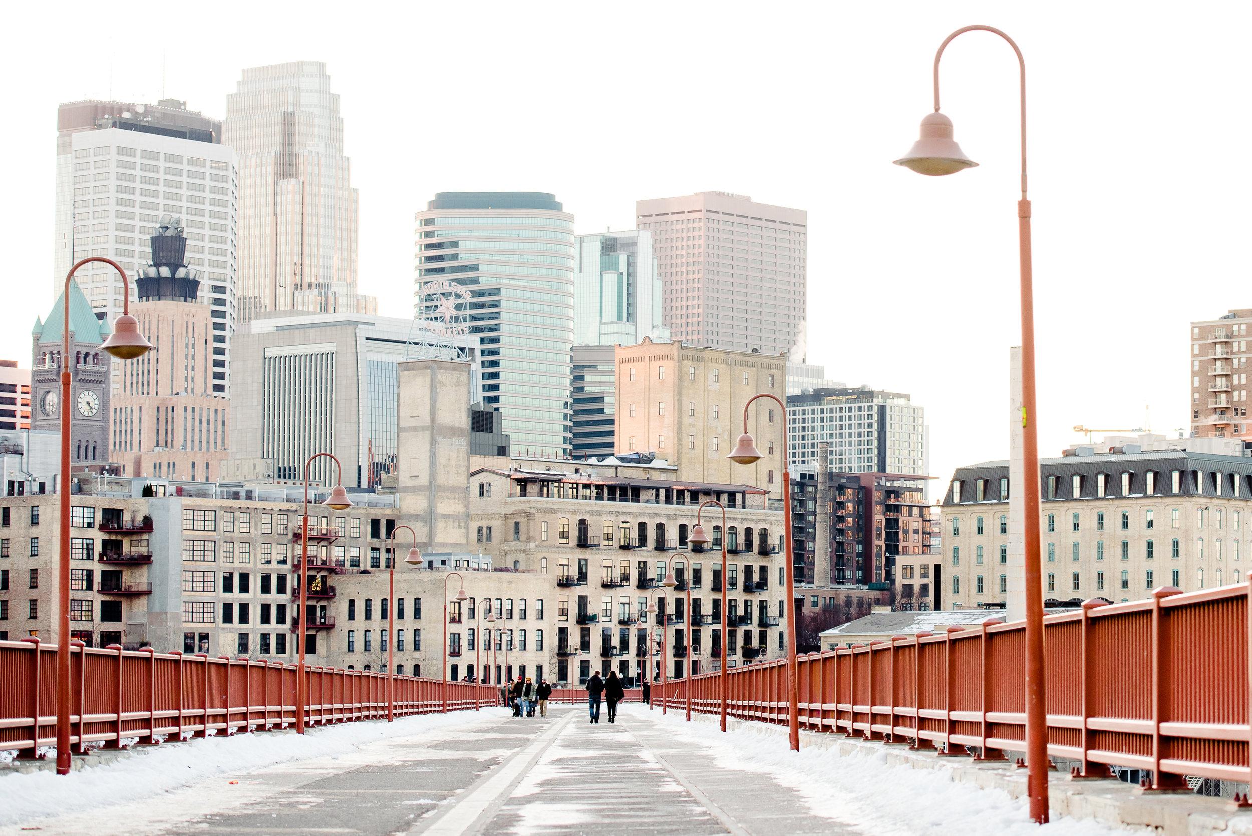 Proposal Ideas Twin Cities Minneapolis Stone Arch Bridge - Skyline View - Minneapolis Minnesota Surprise Proposal and Wedding Photographer