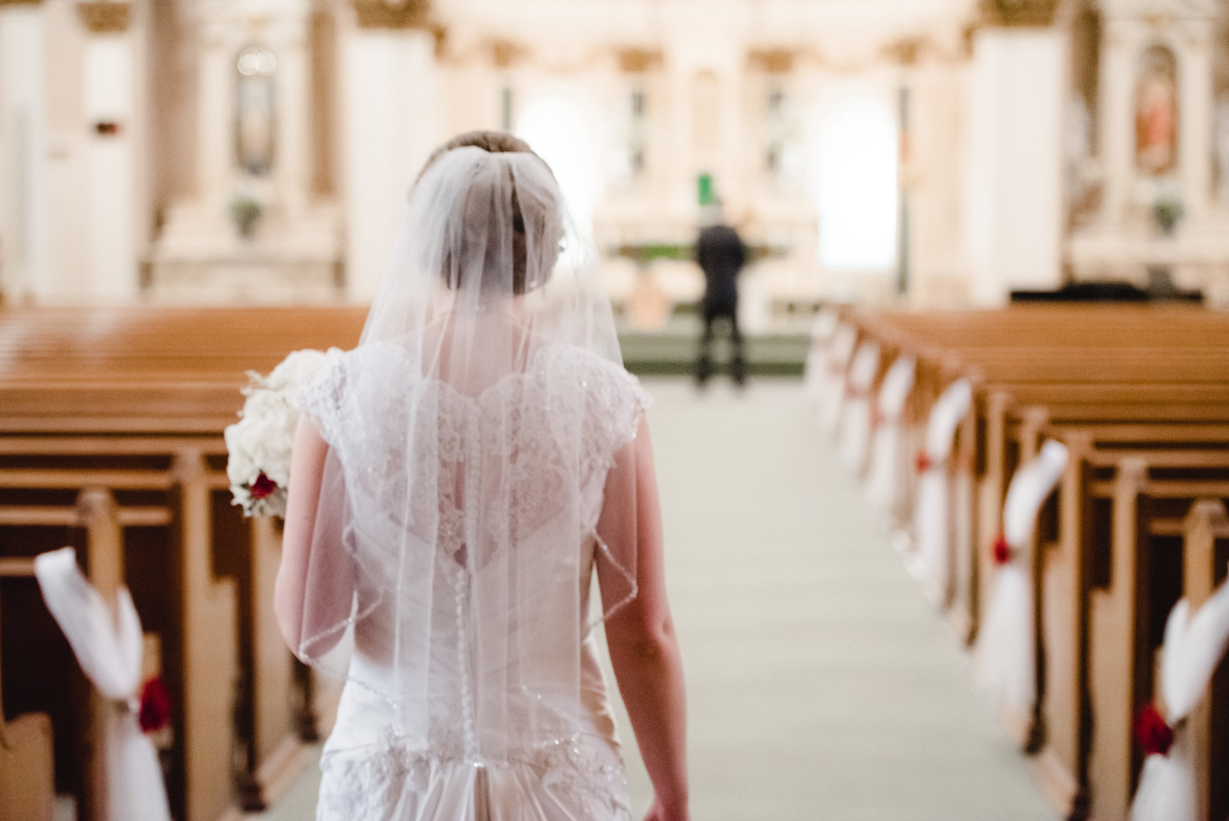 First Look with Bride and Groom in the Sanctuary at St. Peter's Catholic Church - Delano, MN Wedding Photographer