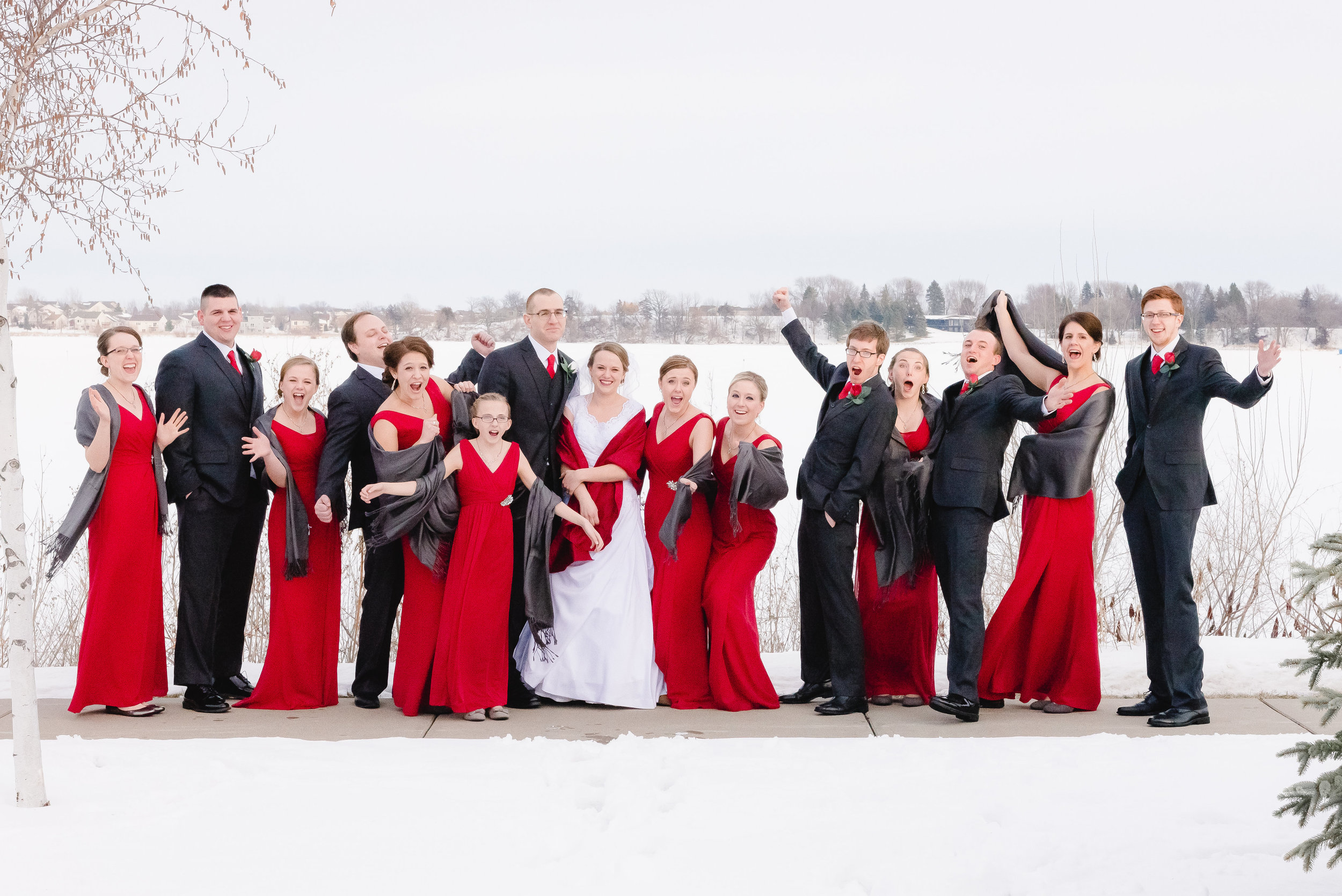 Snowy Red and Black Minnesota Winter Bridal Party Photo at Winsted Lake - Winsted, MN Wedding Photographer