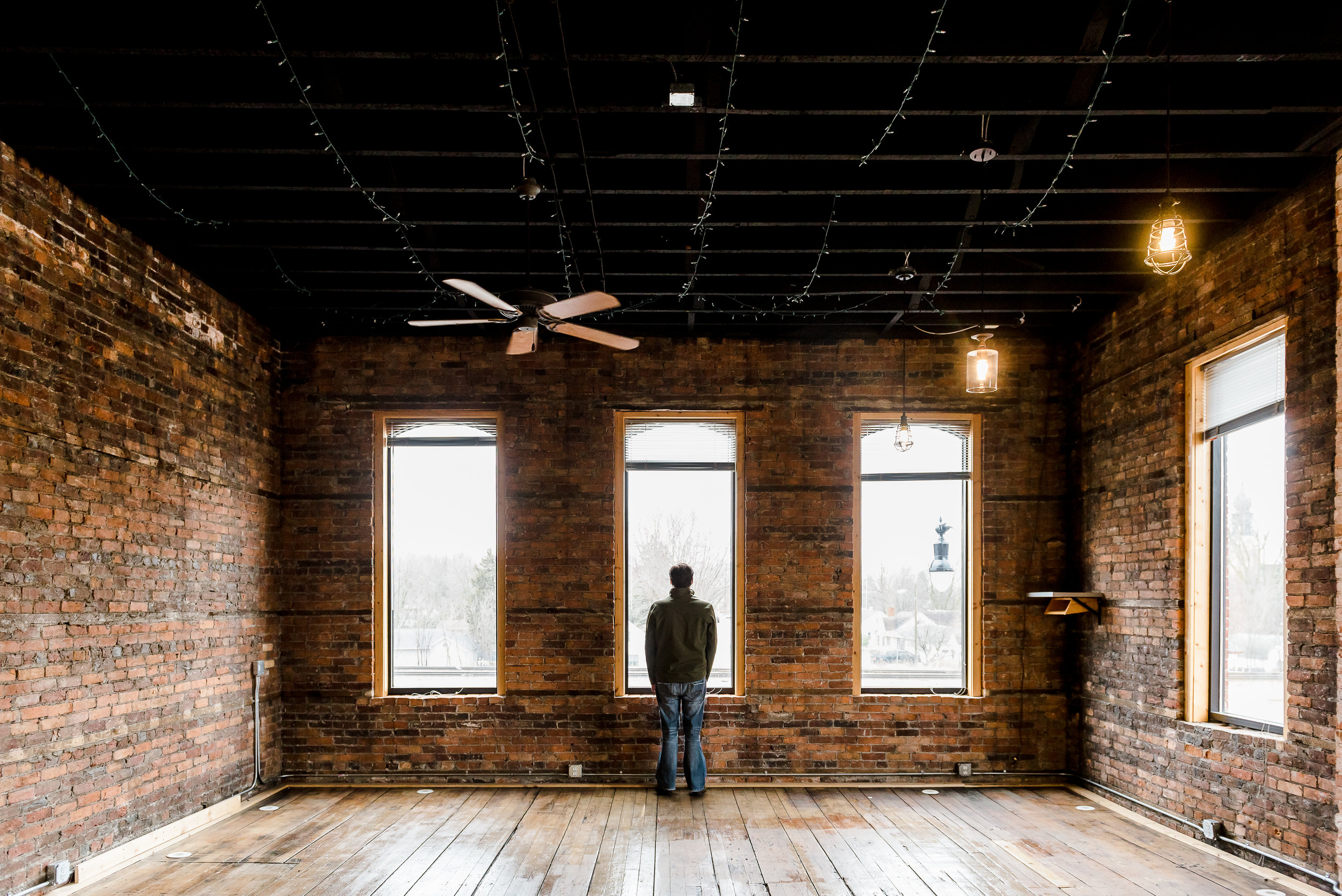 Another view of the studio space, with Nathan for perspective.  LOVE the soaring 12' ceilings and huge windows!