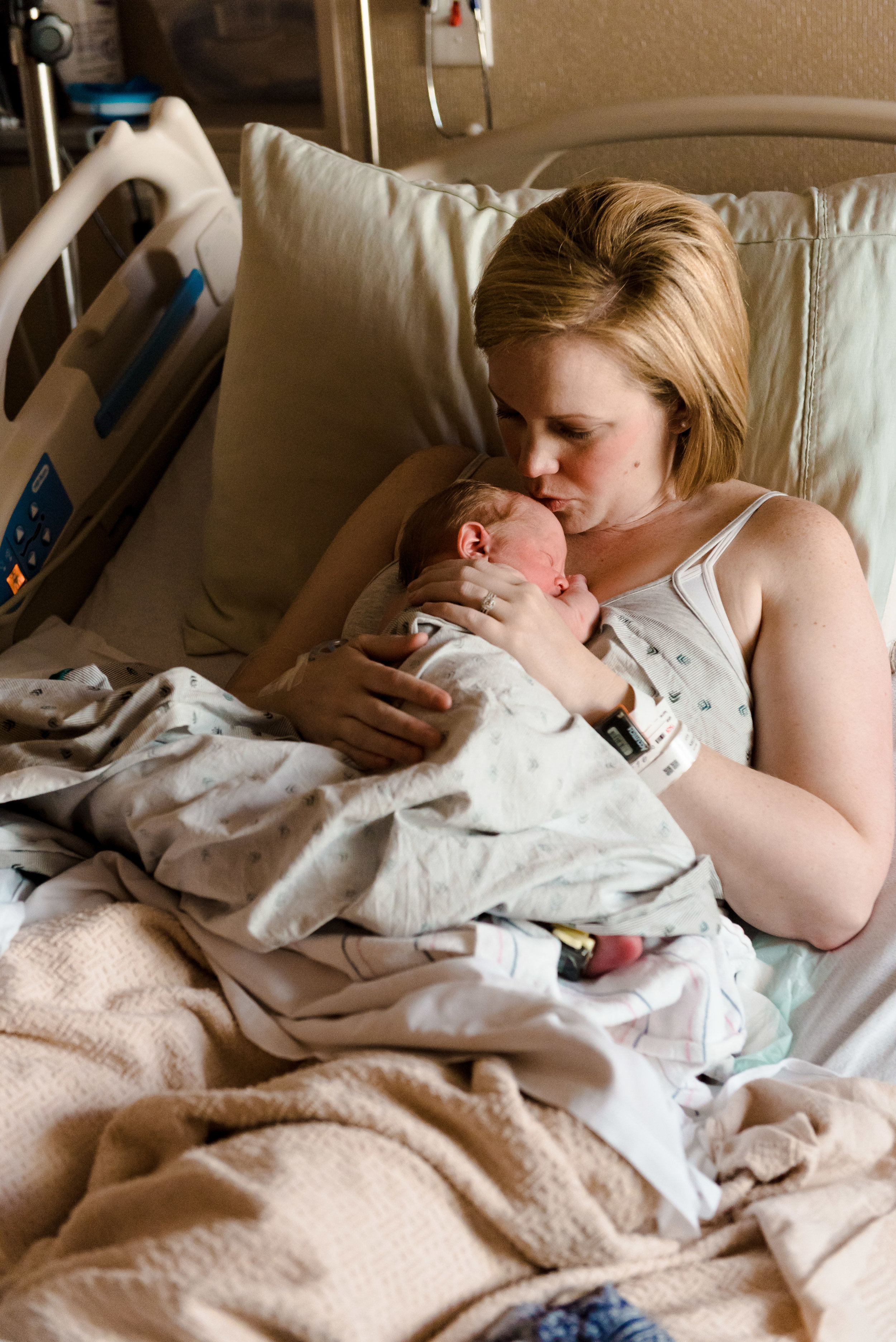 Mom kissing baby Mother Baby Center Birth Photographer Minneapolis MN