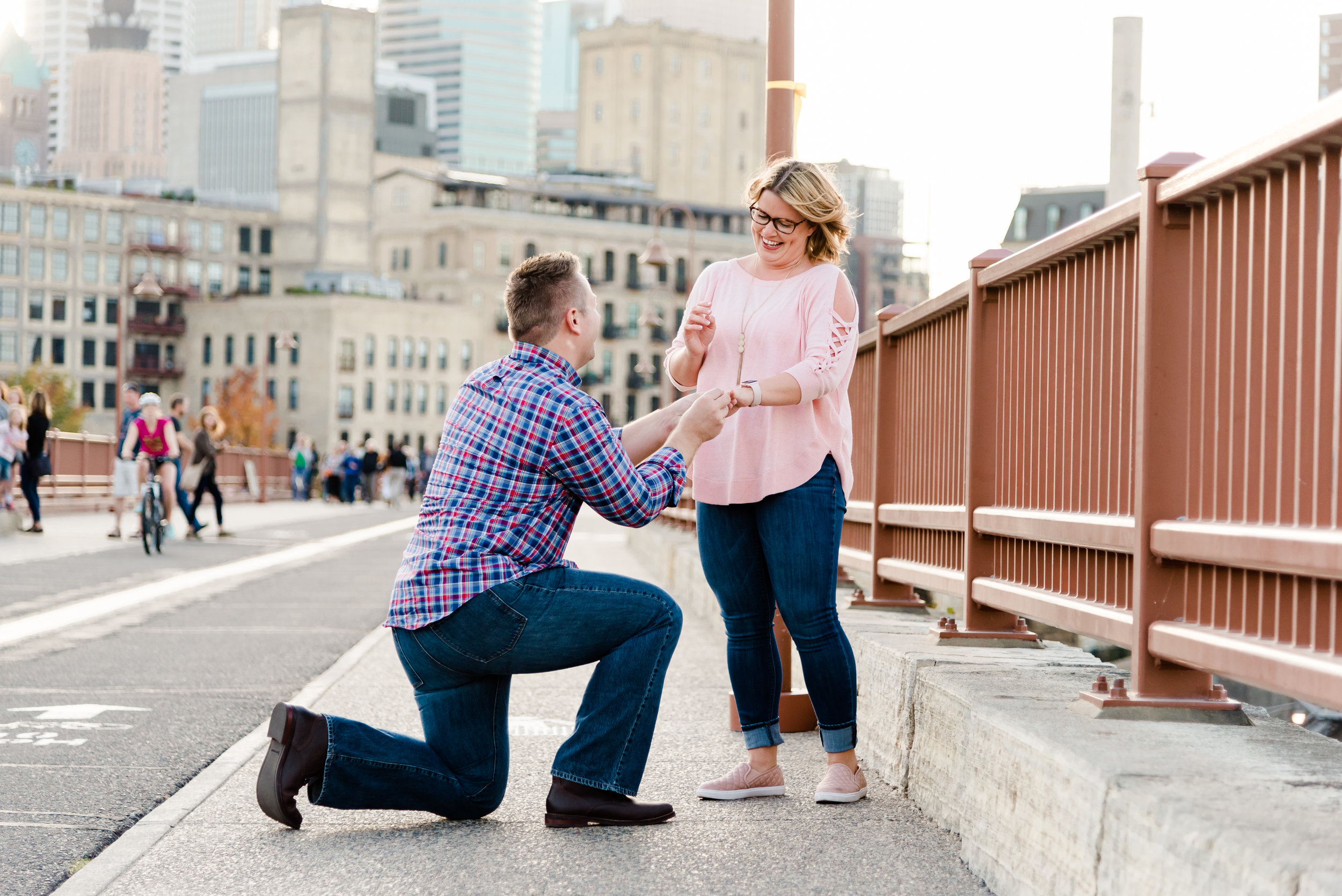 Minneapolis Surprise Proposal Photographer on the Stone Arch Bridge at Sunset