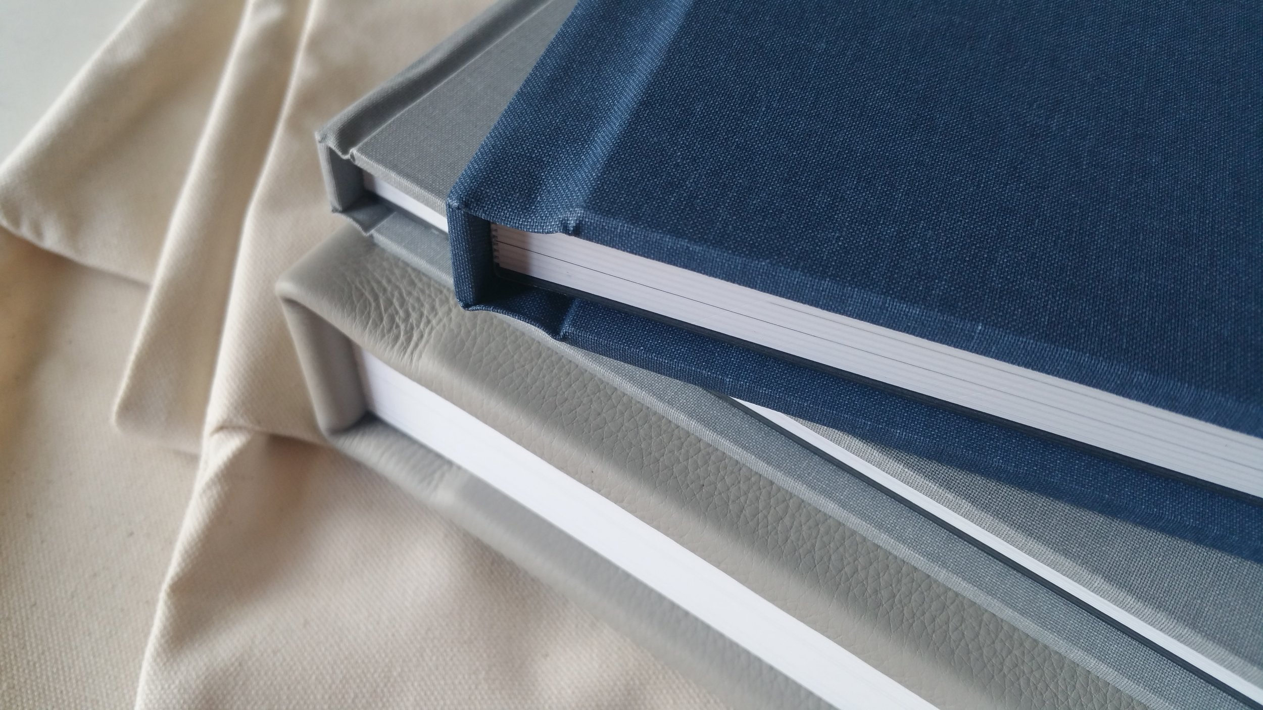 Heirloom albums -- our favorite way to preserve our clients' memories for a lifetime.  These beautiful layflat books are custom designed by Laura and handmade right here in the USA.