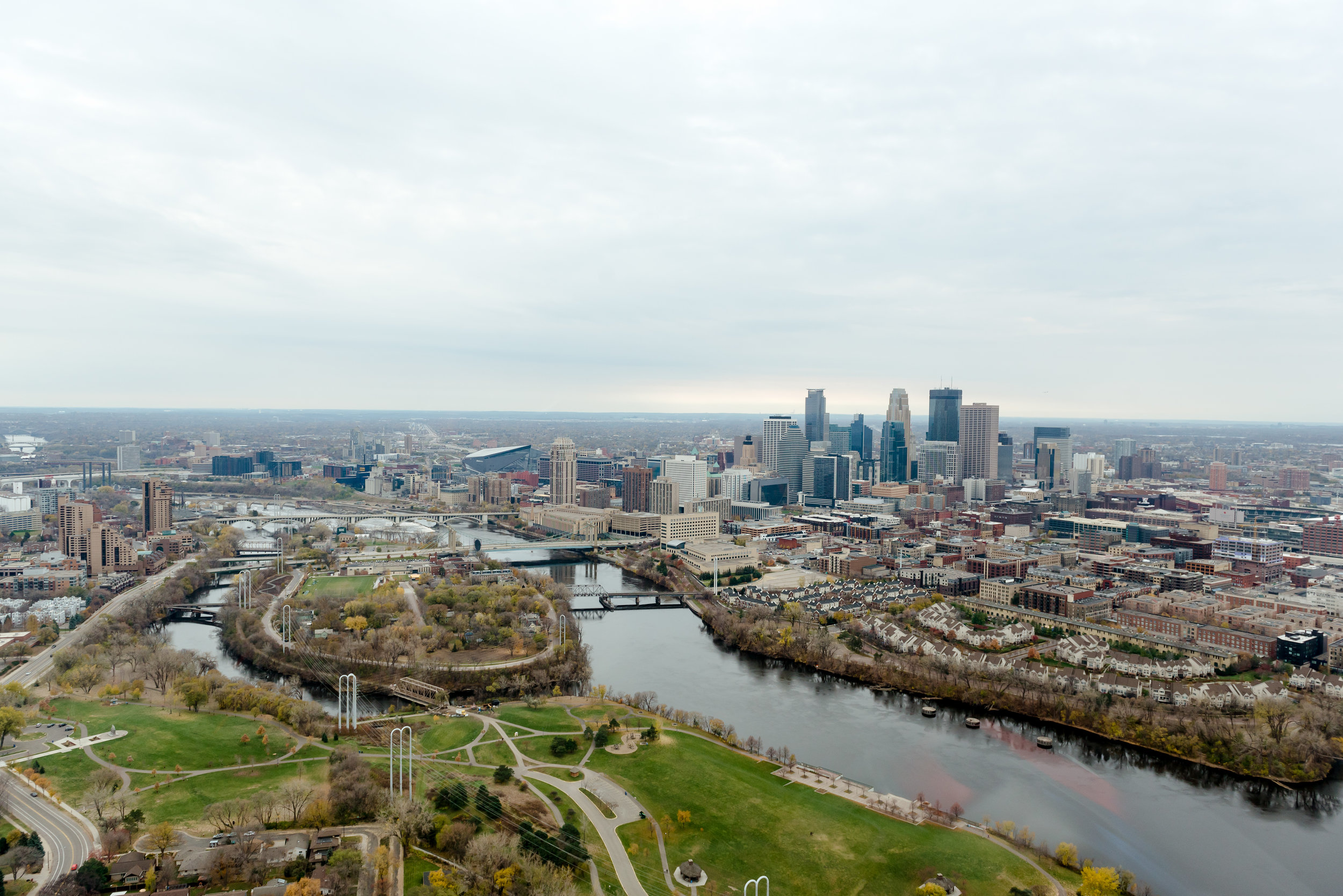 Aerial View of Minneapolis from Helicopter over Mississippi River - Minneapolis Wedding Photographer