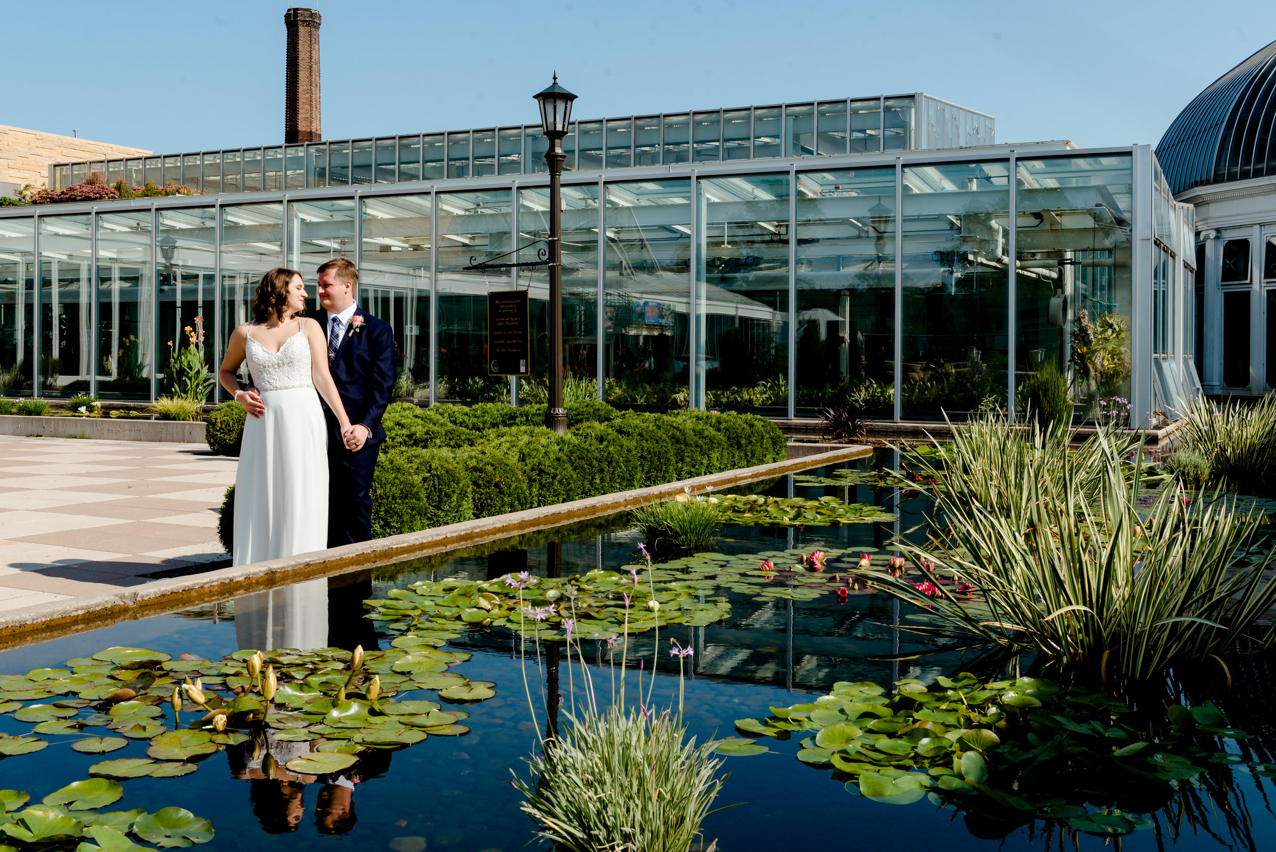 Como Zoo Wedding - Bride and Groom Outside Marjorie McNeely Conservatory after morning wedding - Twin Cities Elopement Photographer
