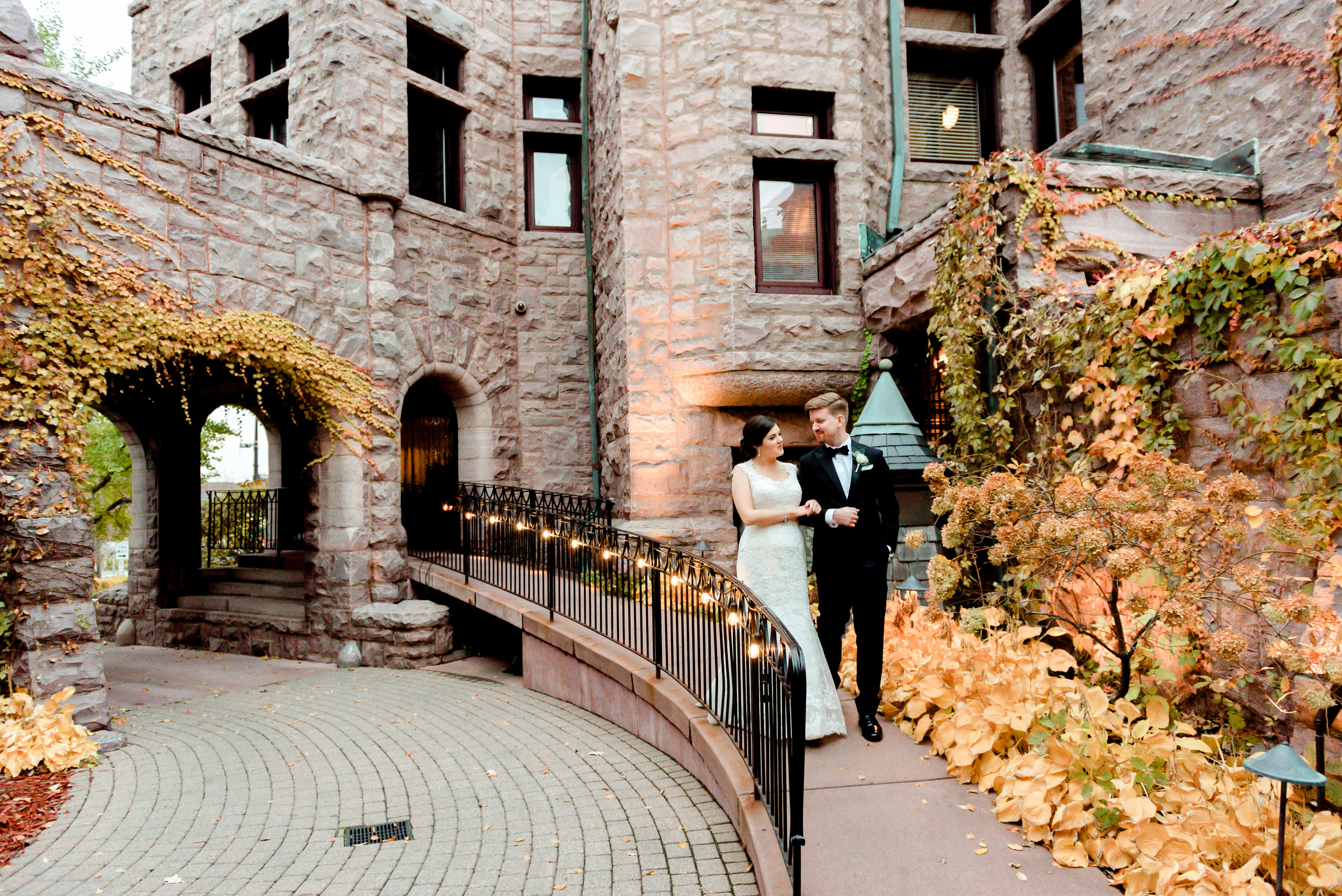 Bride and Groom Walking outside Van Dusen Mansion - Minneapolis Wedding Photographer