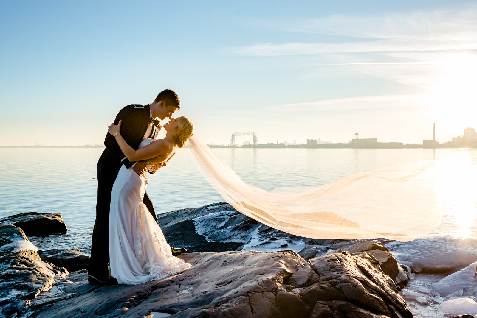 Duluth MN Wedding Photographer - Bride and Groom on Shoreline at Sunset - Romantic Wedding Photos