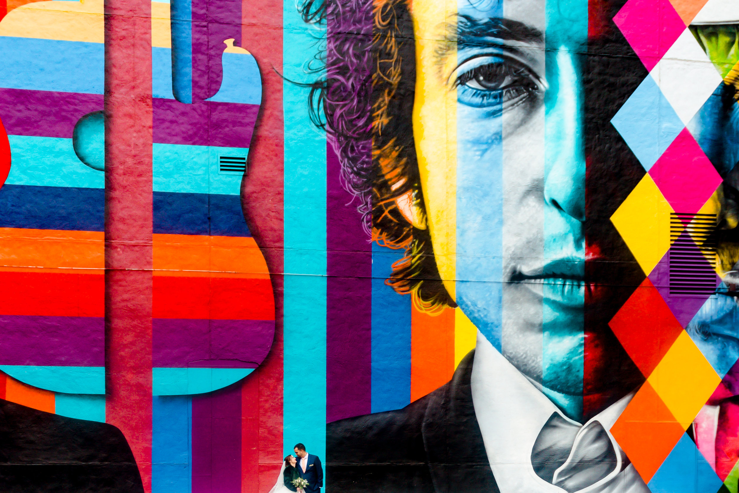 Downtown Minneapolis Wedding Photos - Bob Dylan Mural with Bride and Groom - Minneapolis Wedding Photographer