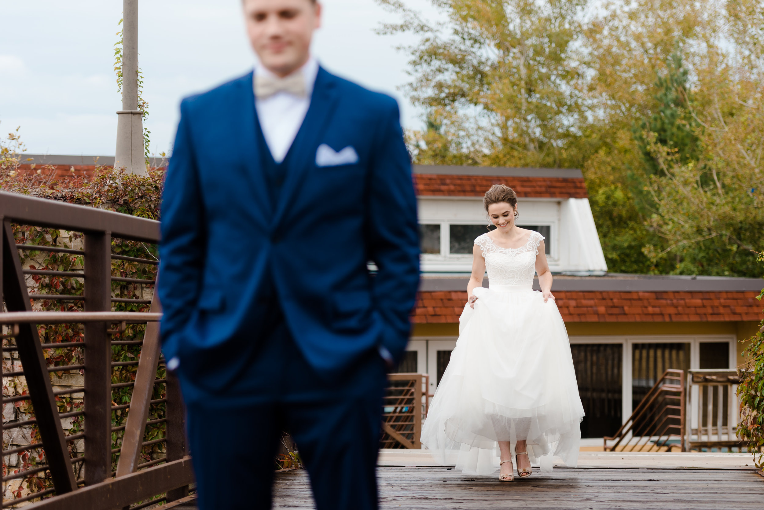 Elm Creek Chalet Wedding - Bride and Groom First Look on Bridge - Romantic Wedding Photos in MN