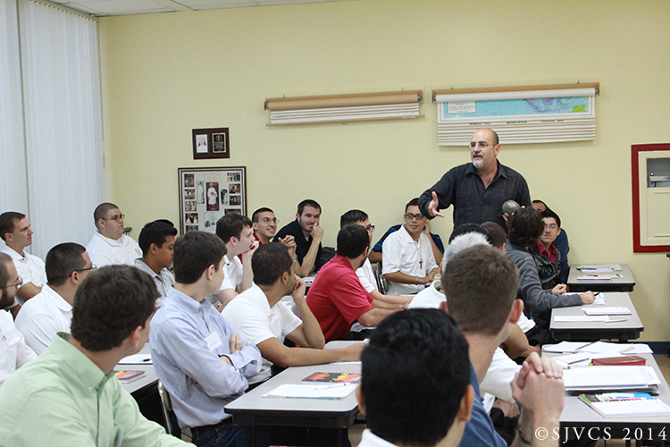 Fr. Robert Vallee captivates the class with tales of philosophy