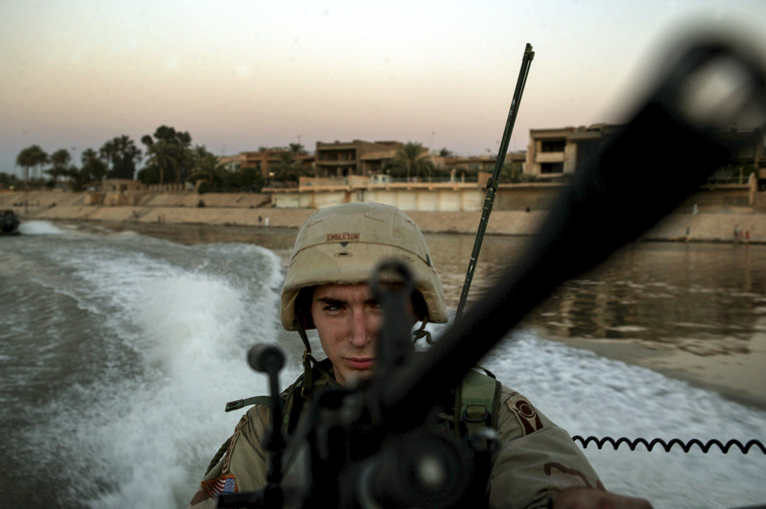 Alpha Company's David Embelton with the 3rd Battalion 124 Infantry keeps an eye on the waters during a boat patrol of the Tigris river.
