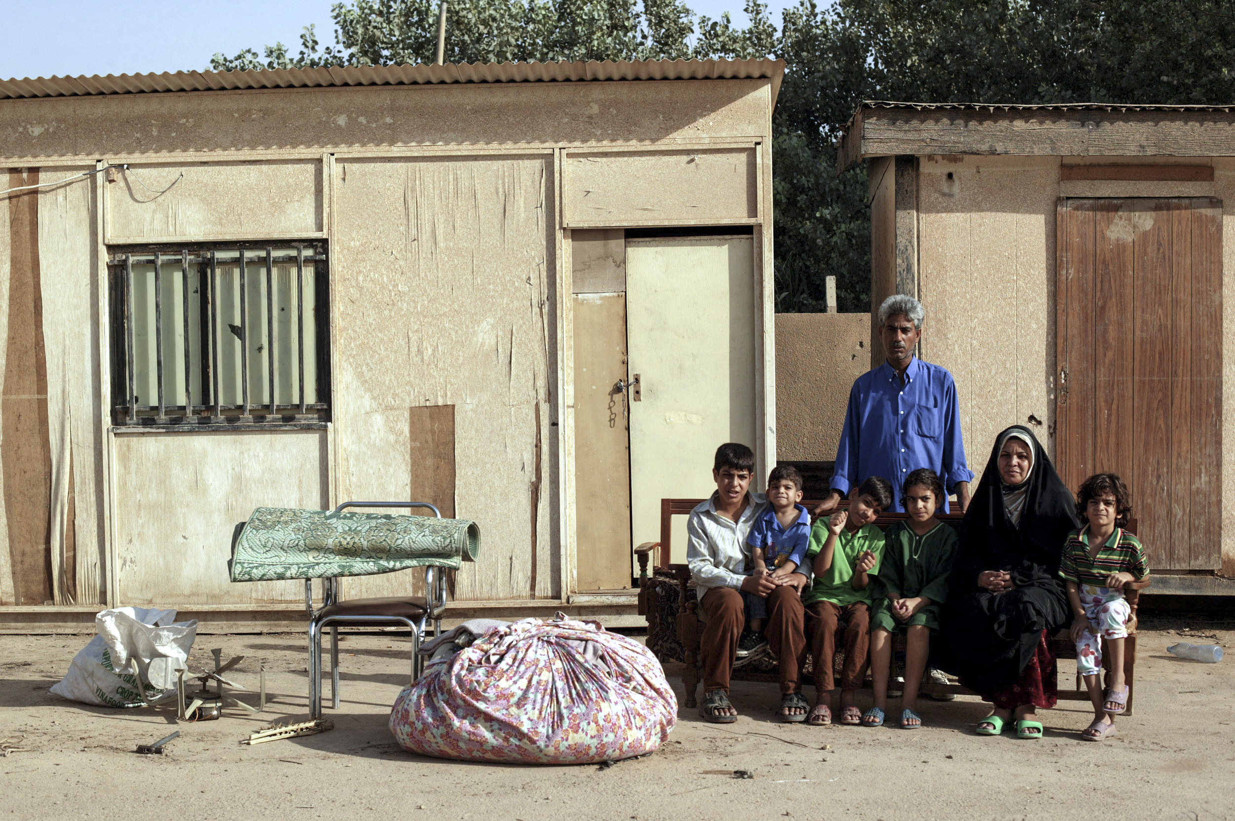 After Sadam Hussein's regime fell, Sadai Ali Khairalah's family was forced out of their home by Iraqi Iranians returning to reclaim their property after a period of exile.