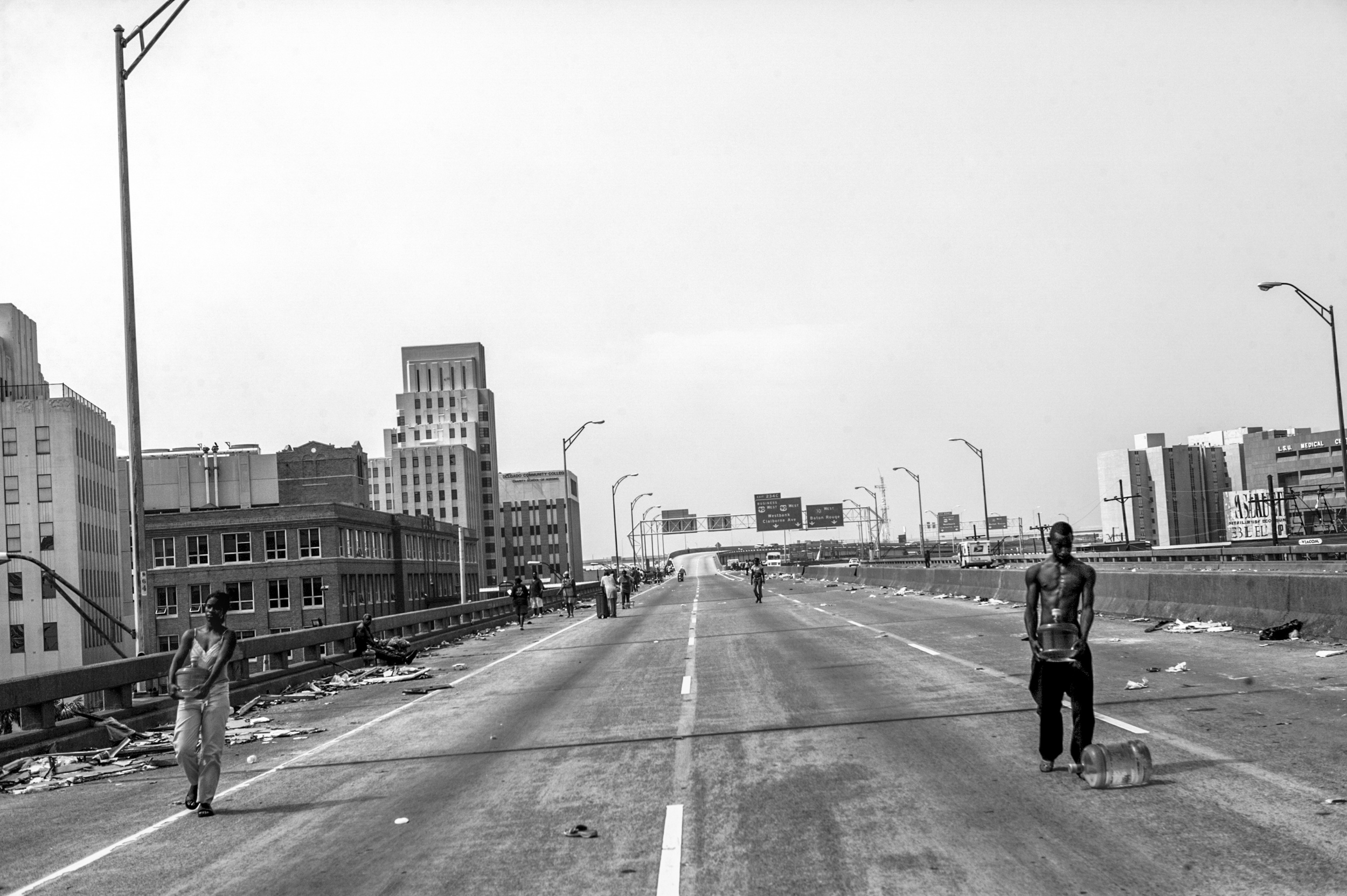 For up to four days almost 300 New Orleans residents, mostly African Americans, were stranded on Interstate 10 until they were finally rescued by aid helicopters. During the four days on this asphalt camp they ran out of water, food and medicine. People died waiting for help.