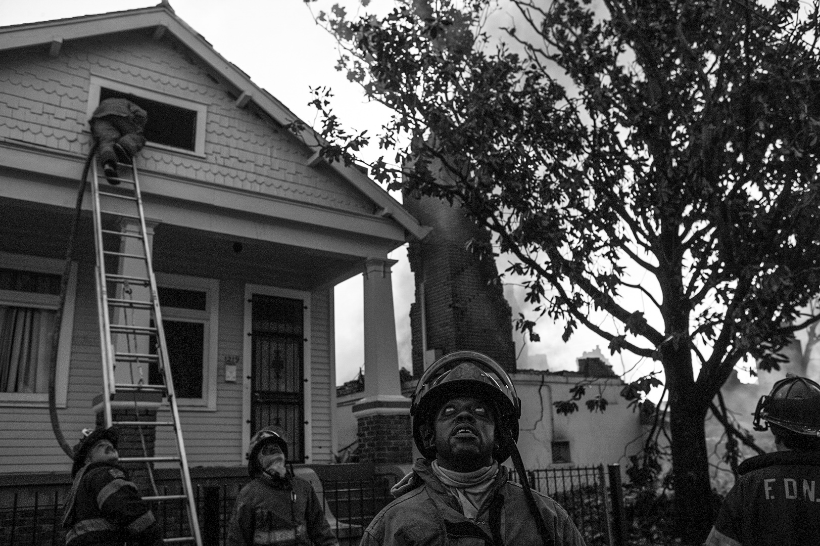 Firefighters at the scene of a house fire.